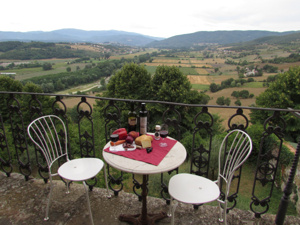 An affordable picnic: Local cheese, bread, wine, fruit & vegetables, salami.