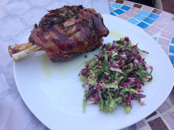 Bacon-wrapped leg of pork