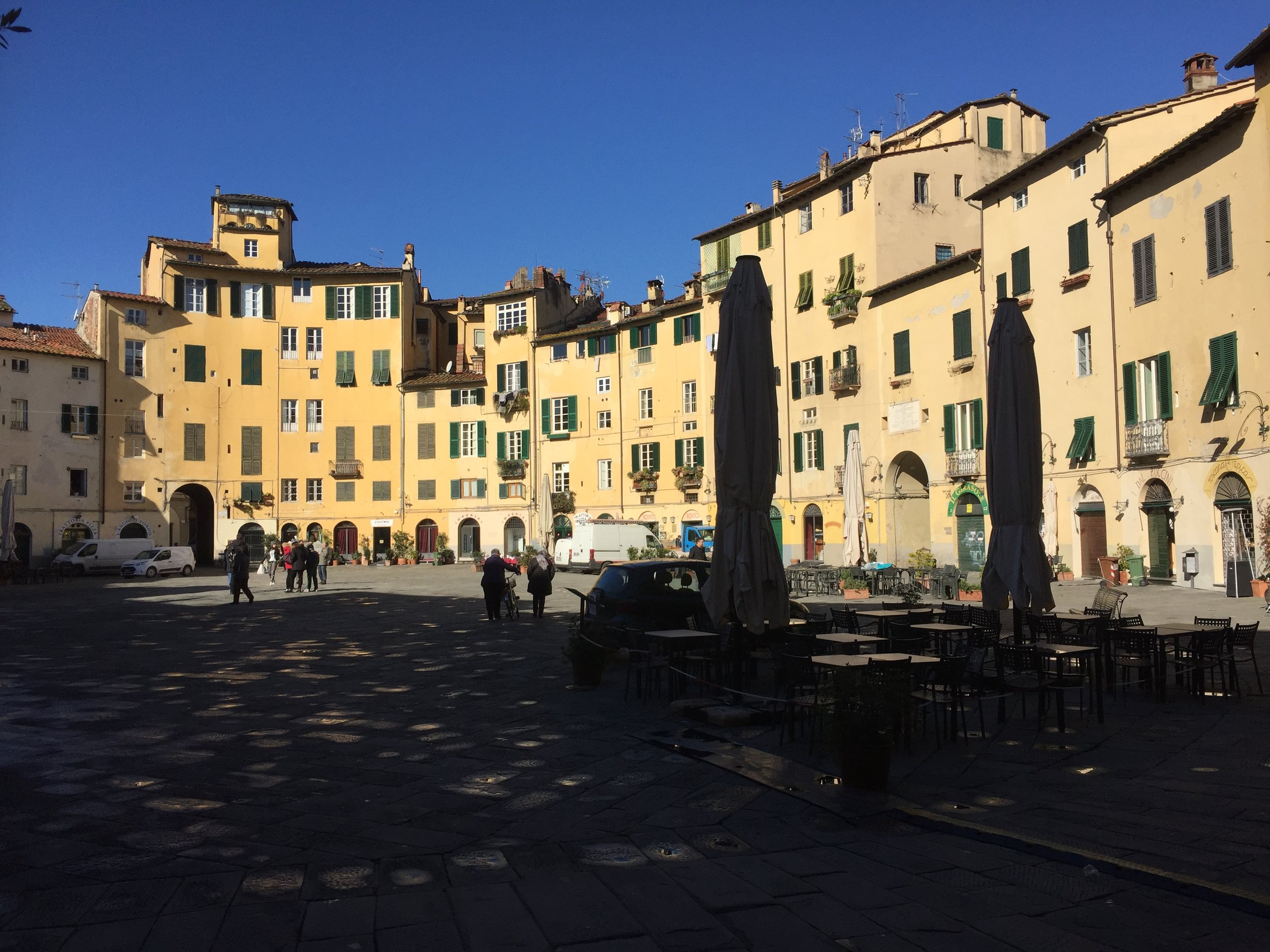 Apartments face the cafes on the Piazza Anfiteatro.