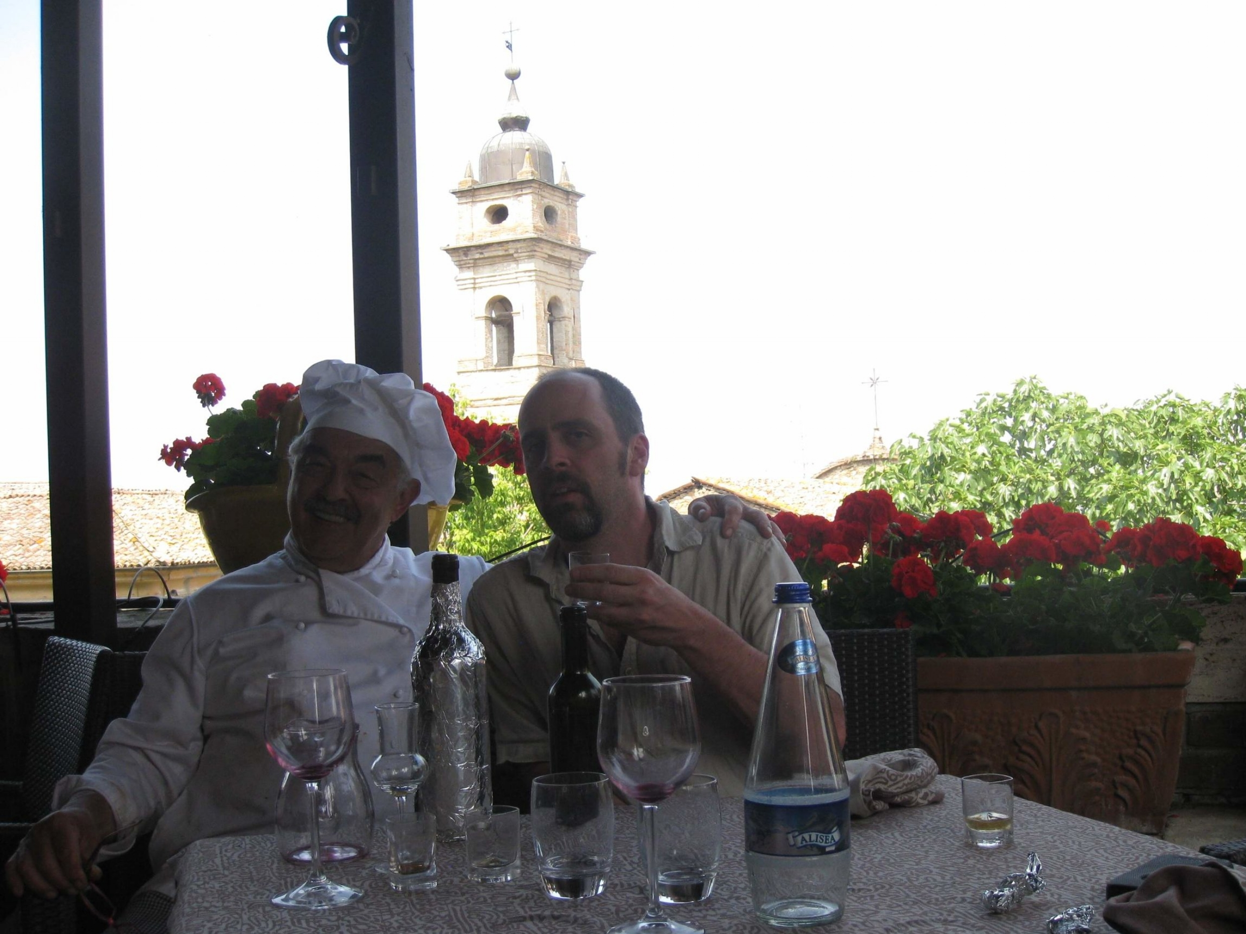 """Chef Eros sits with Matt after several glasses of """"Rosolio""""."""