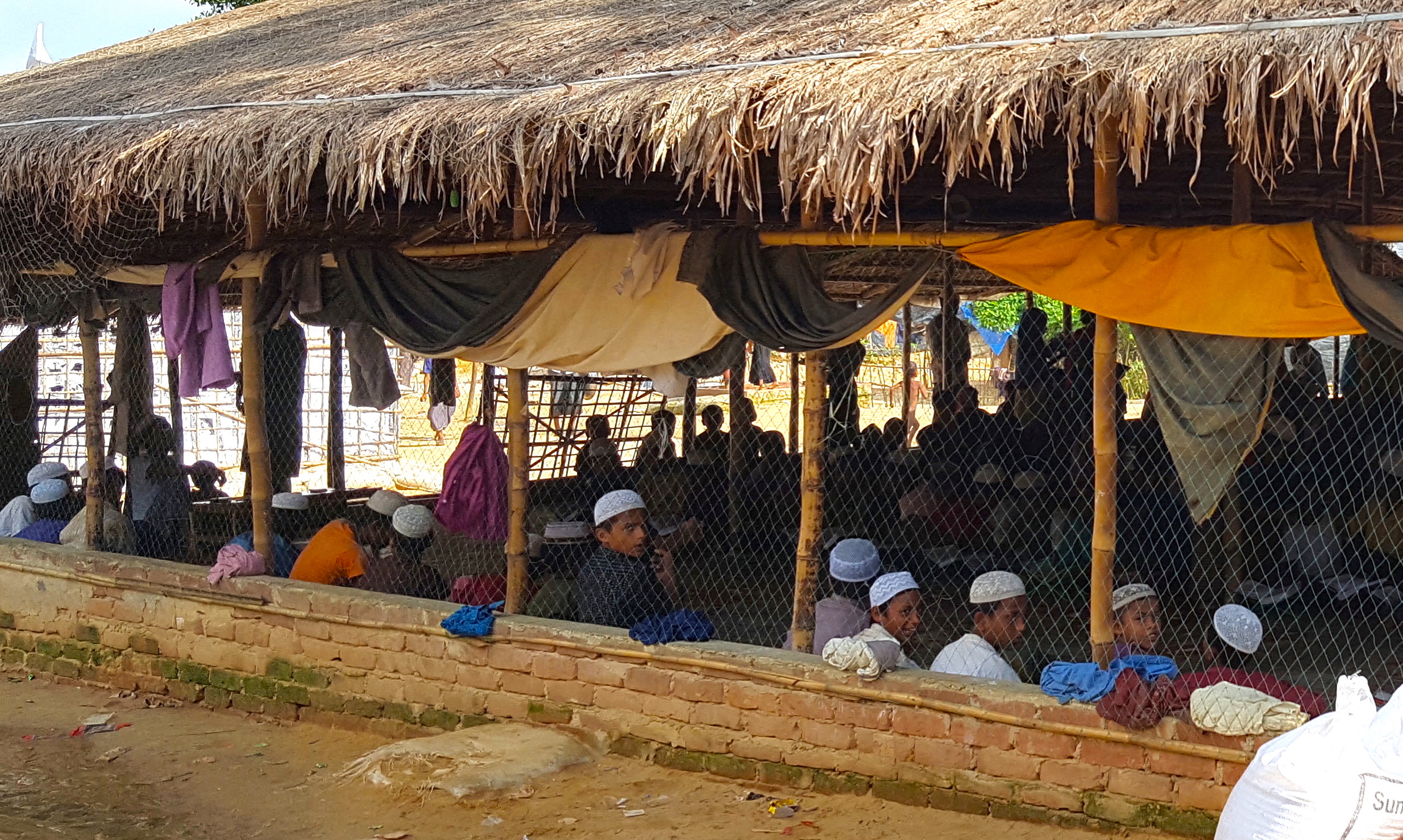 A humanitarian aid organization and Bangladeshi locals set up this  madrassa  for new refugee arrivals. Both locals and refugees take great care of such ad hoc facilities. Although Rohingya refugees are largely illiterate, nearly all can read and recite the Qurʾan.