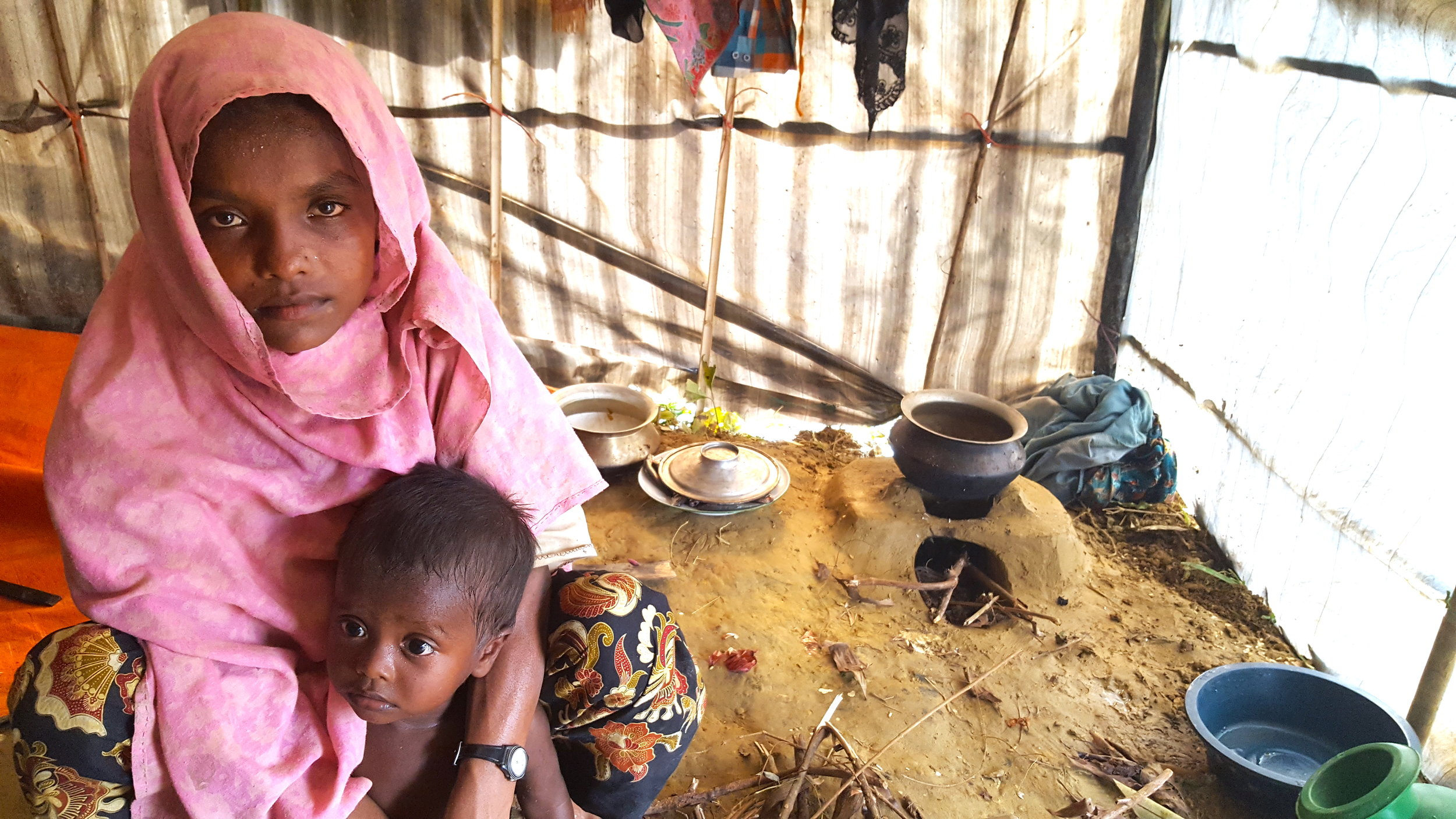 Most dwellings in Rohingya refugee camps appear like this on the inside. Many women and girls avoid venturing outside of these makeshift homes to avoid being kidnapped by traffickers or local criminals. In this sense, the immediate threat of sexual violence is present in both Myanmar and Bangladesh. The child in the photo did not own any clothing.