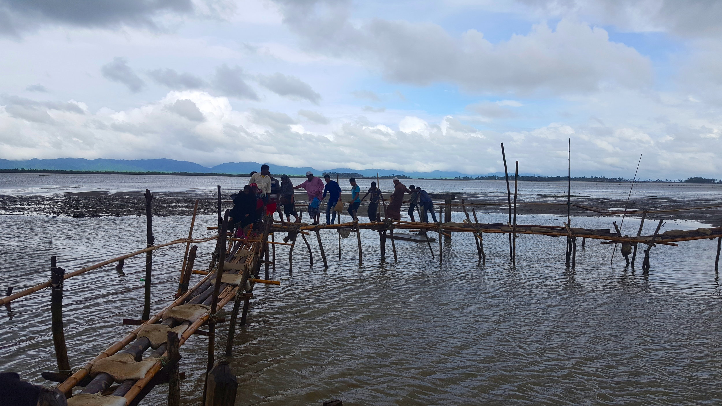 Hundreds of refugees have crossed into Bangladesh using this makeshift bamboo bridge built by Friendship, a Bangladeshi non-governmental organization. This precarious bridge has served as a replacement for the one that preceded it, which collapsed under heavy rains. The Myanmar border lies across the water.
