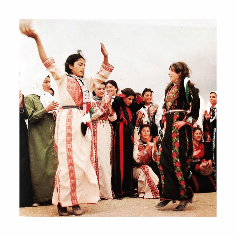 Palestinian women dancing in traditional Thoub (dress).