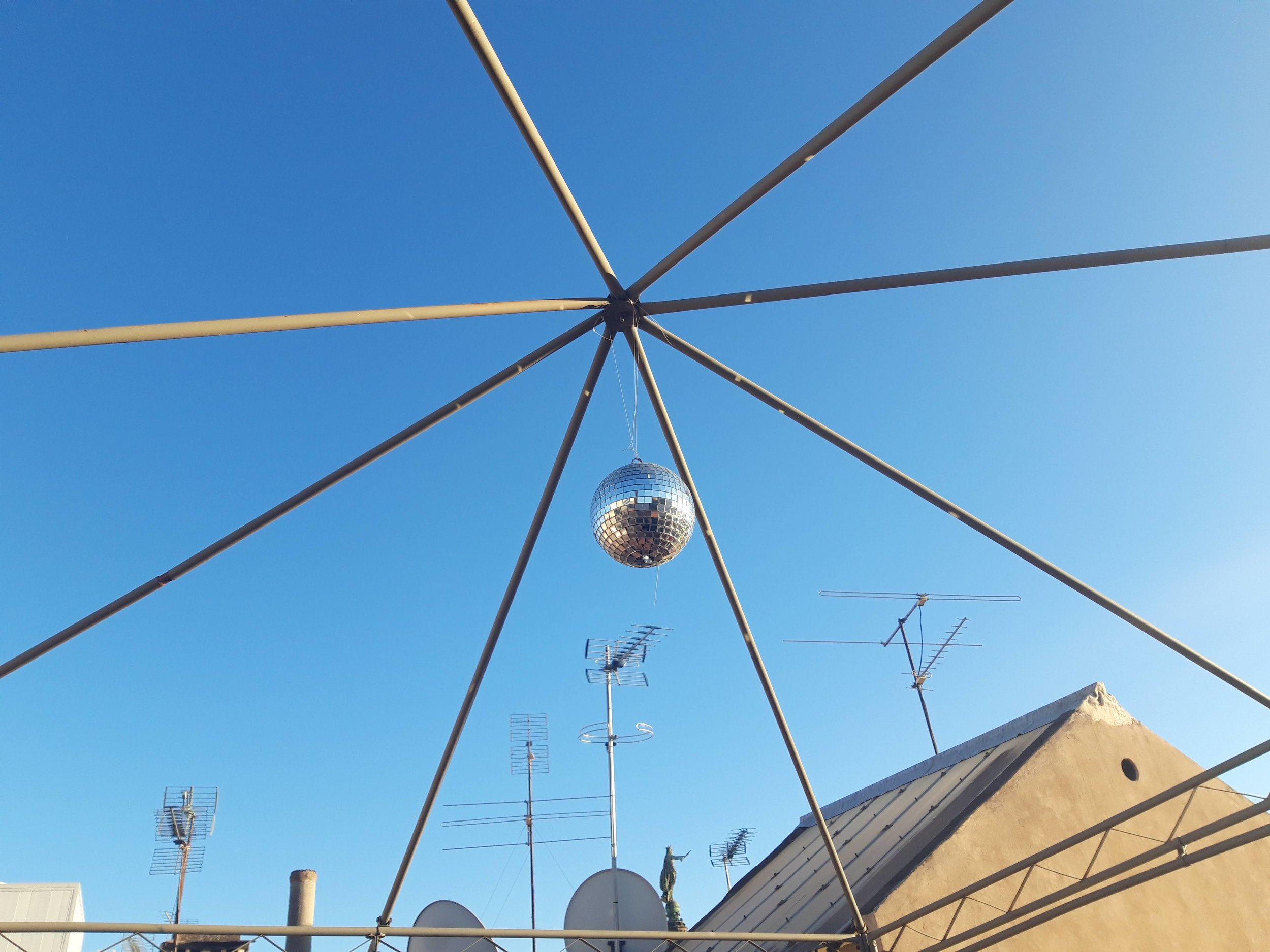 disco balls spinning from catalunyan rooftops, el gótico, barcelona, 10 January 2019