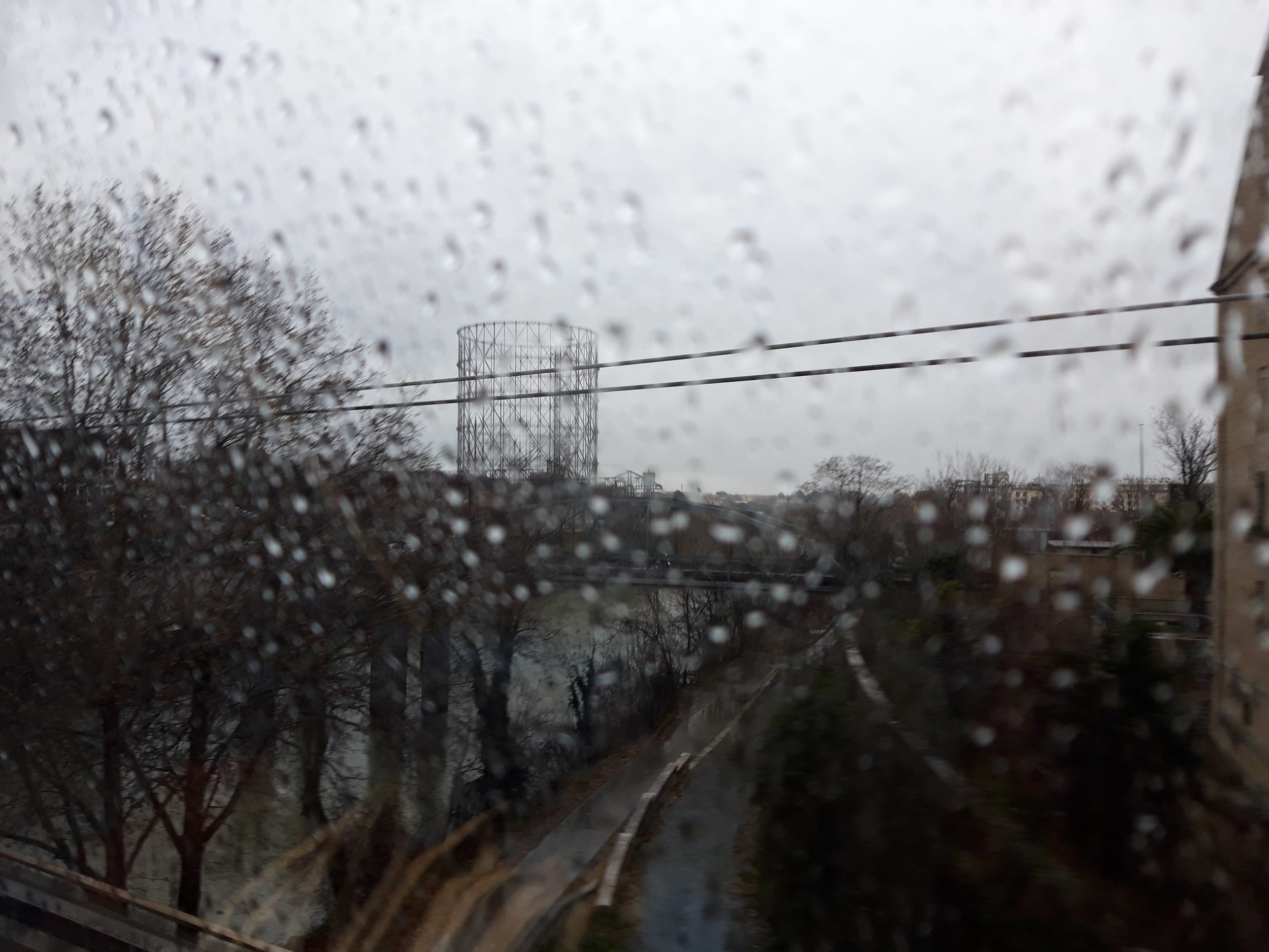 the gazometro along the banks of the tevere from a westbound train window, 23 january 2019