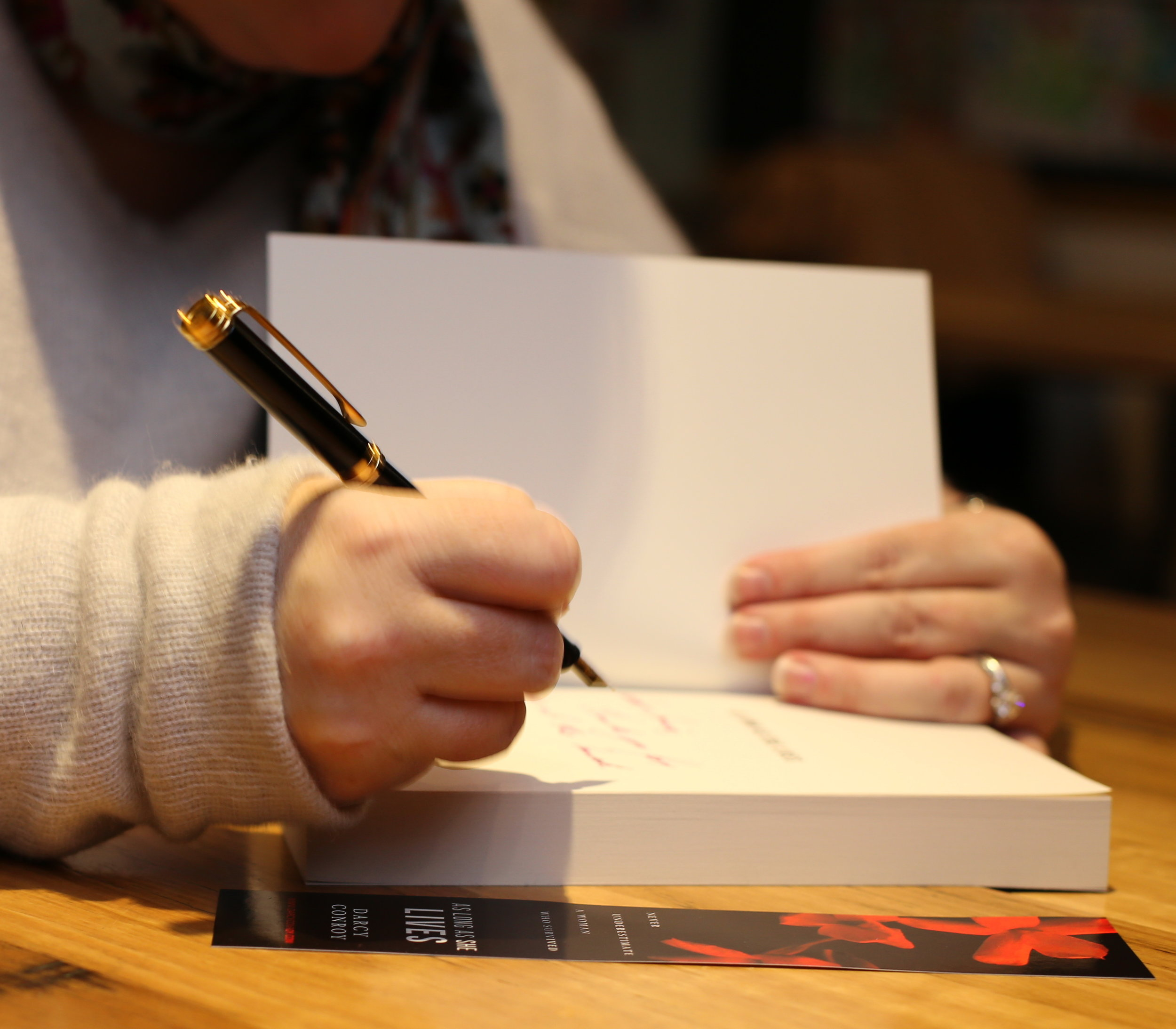 Close-Up-Signing.jpg