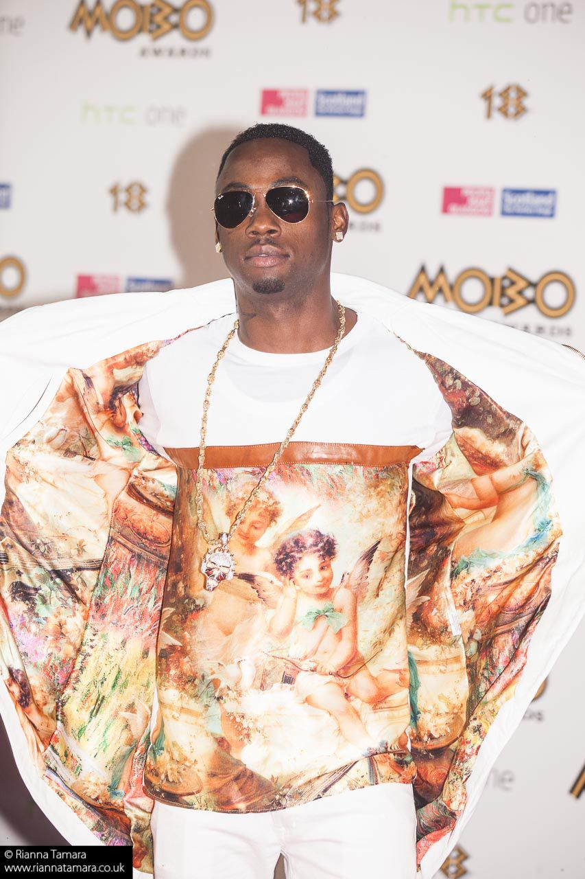 stylo g   renaissance tshirt and white leather tailcoat @mobos red carpet