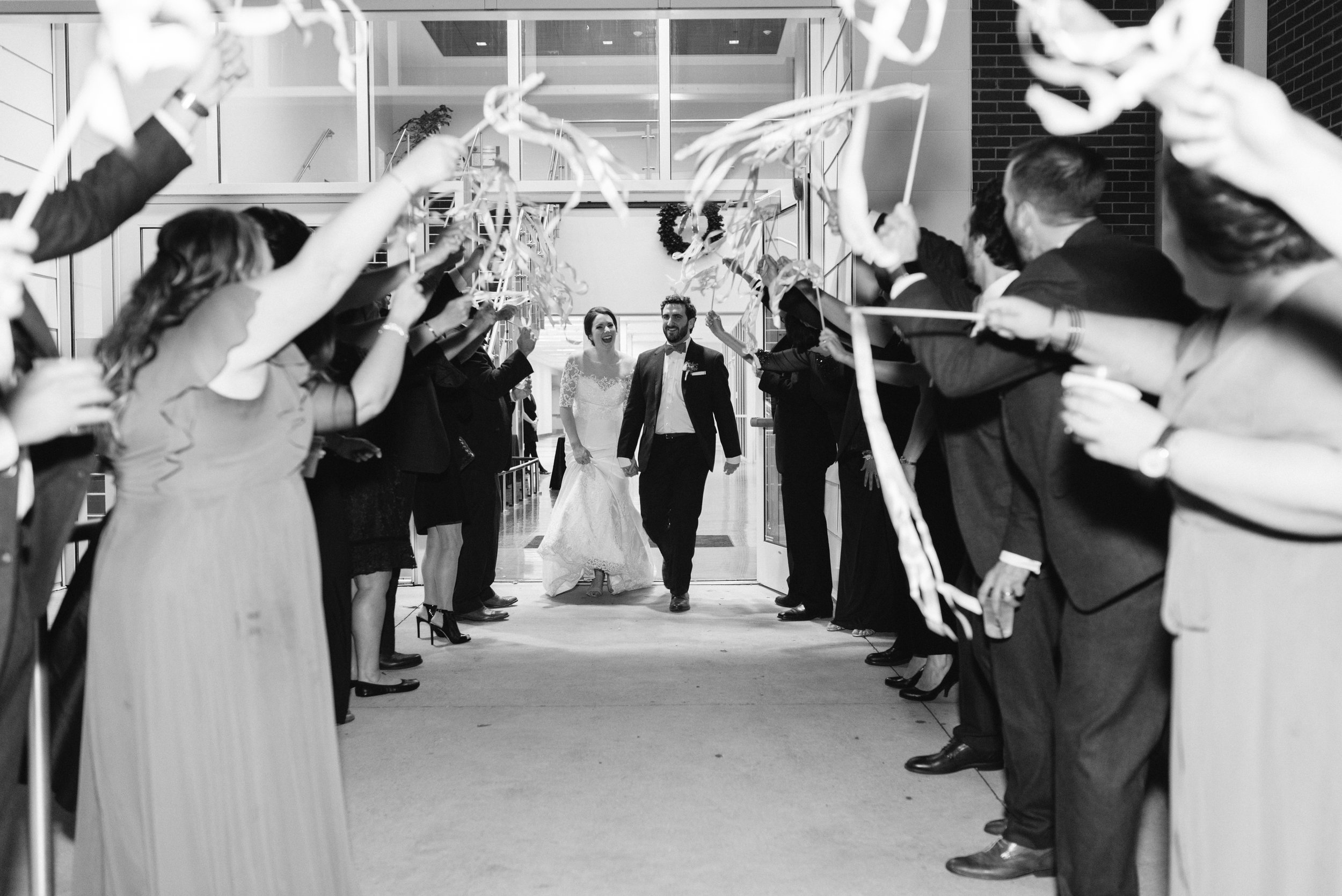 Southern Fete, Southern Wedding, UL Student Union Ballroom, Ribbon Exit, Bride and Groom, Sarah Beth Photography