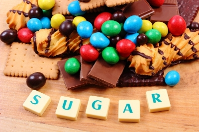bigstock-A-Lot-Of-Sweets-With-Word-Suga-99835019.jpg