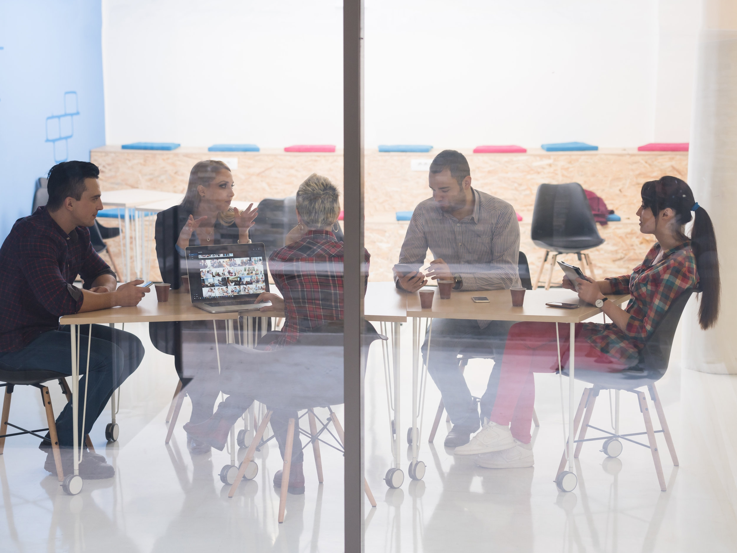 storyblocks-startup-business-team-on-meeting-in-modern-bright-office-interior-brainstorming-working-on-laptop-and-tablet-computer_BOQjkVk3W.jpg