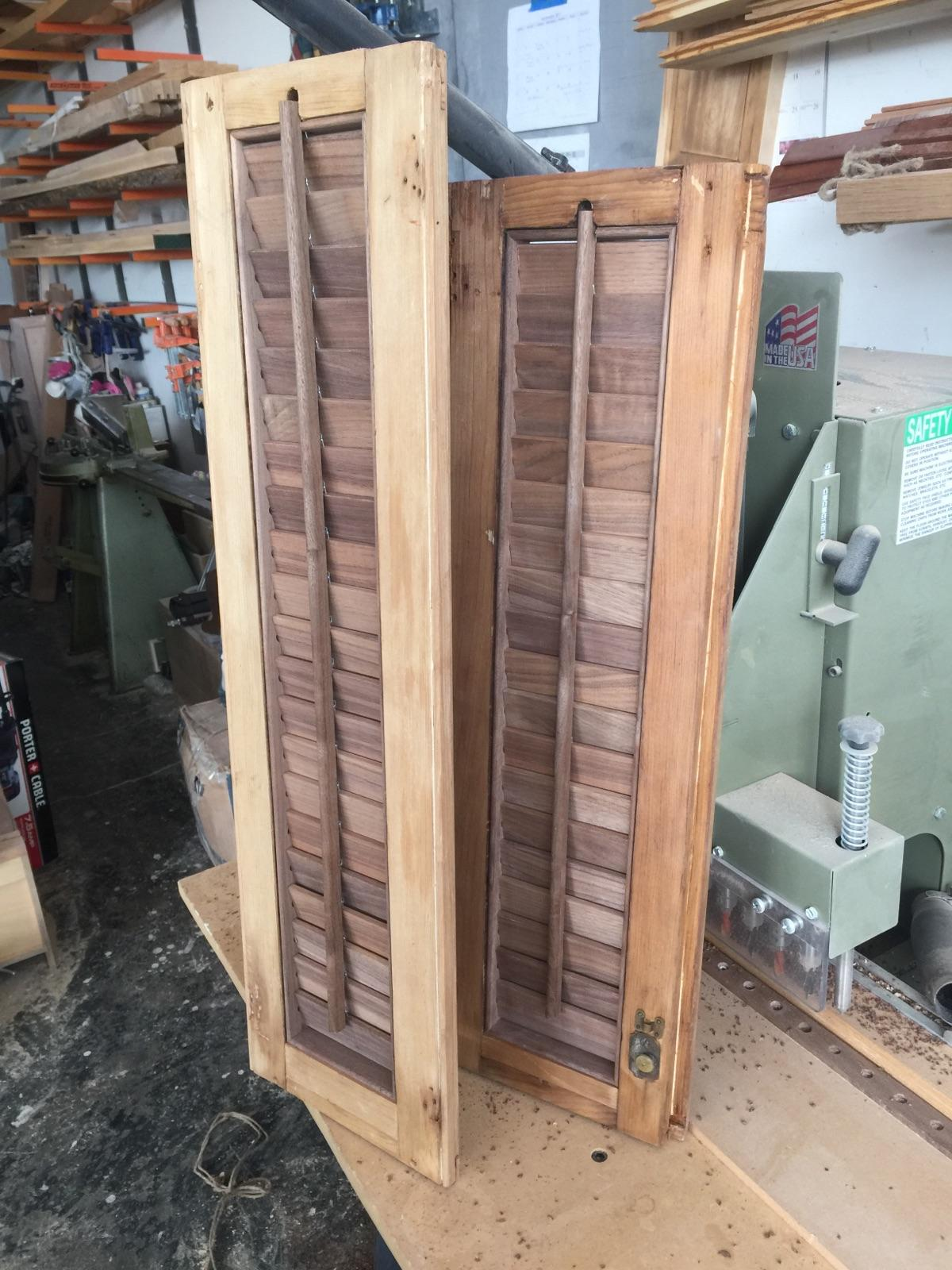 The original louvers looked to be (severely sun and rain damaged) black walnut. We just happened to have a little black walnut laying around, and used it to recreate the louver assemblies. It looks great unfinished, framed up by the old unfinished white pine.