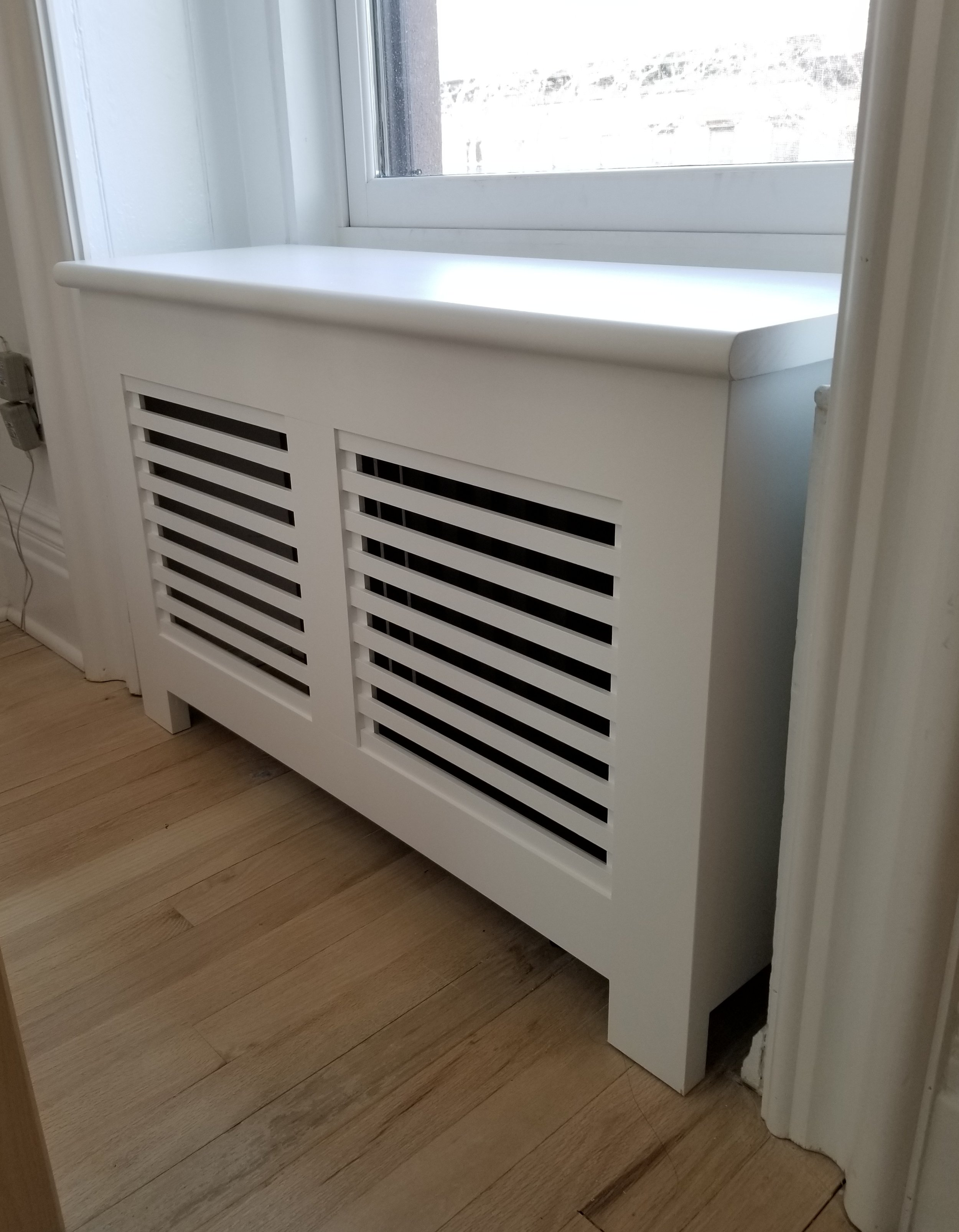 Wooden slatted radiator cover