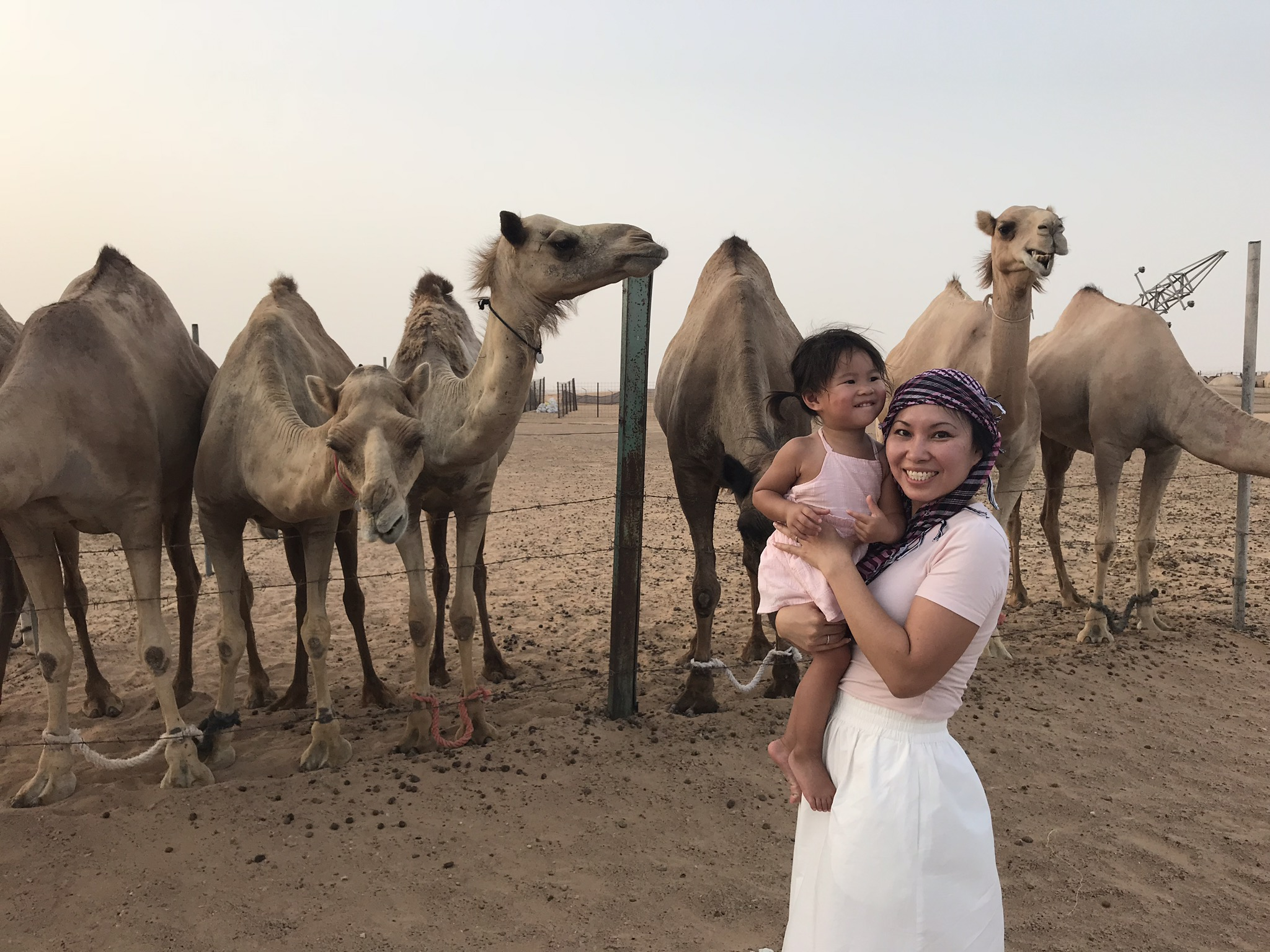 Just feeding some camels with Mom!