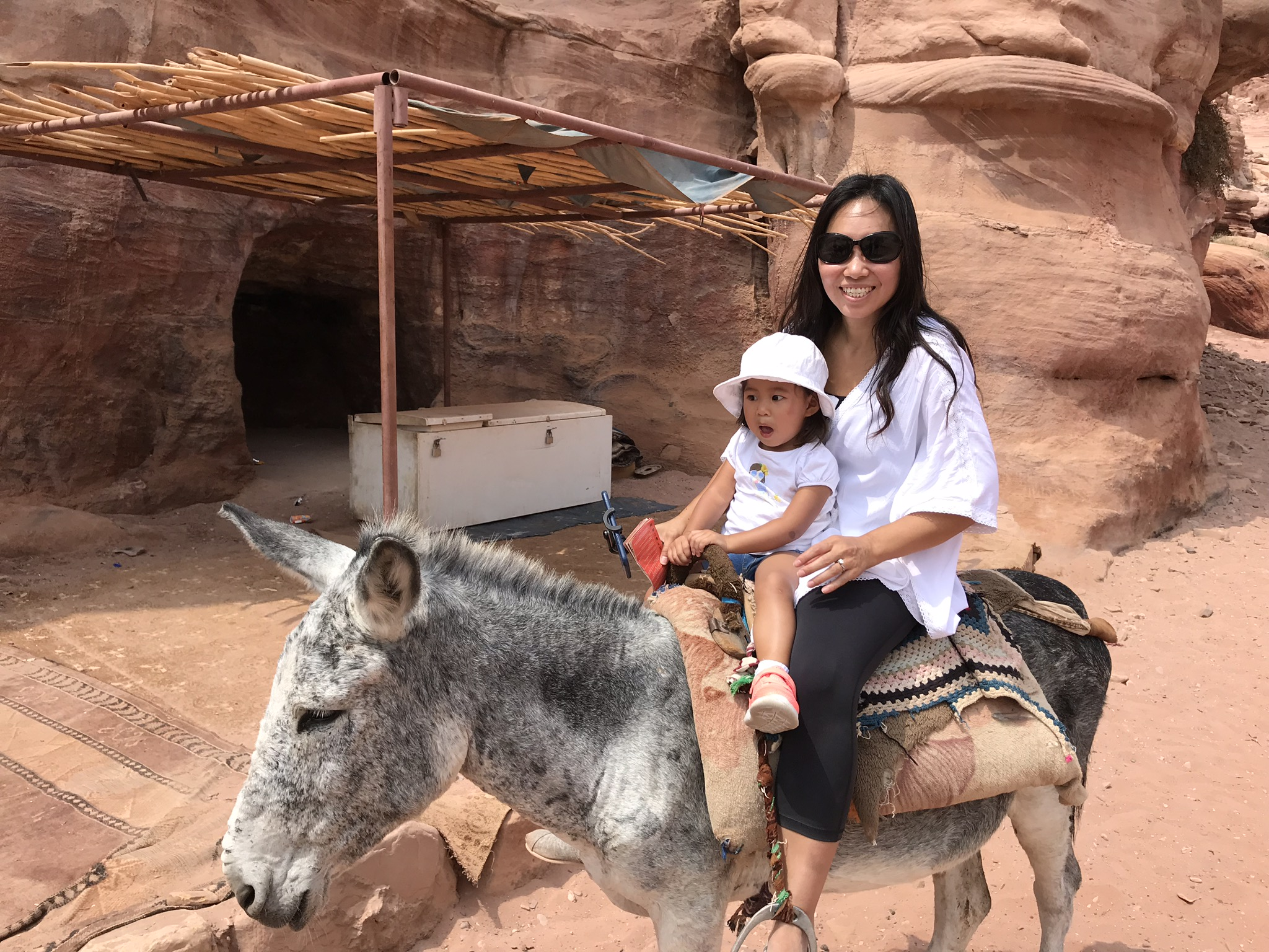 Mommy look, I'm on a donkey!