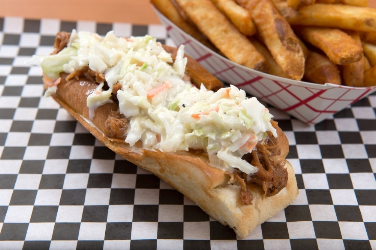 The Hog  BBQ pulled pork topped with coleslaw on a grilled new england bun.