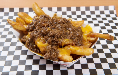 Chili Cheese Fries  - Thick cut beer battered fries topped with chili & cheese.