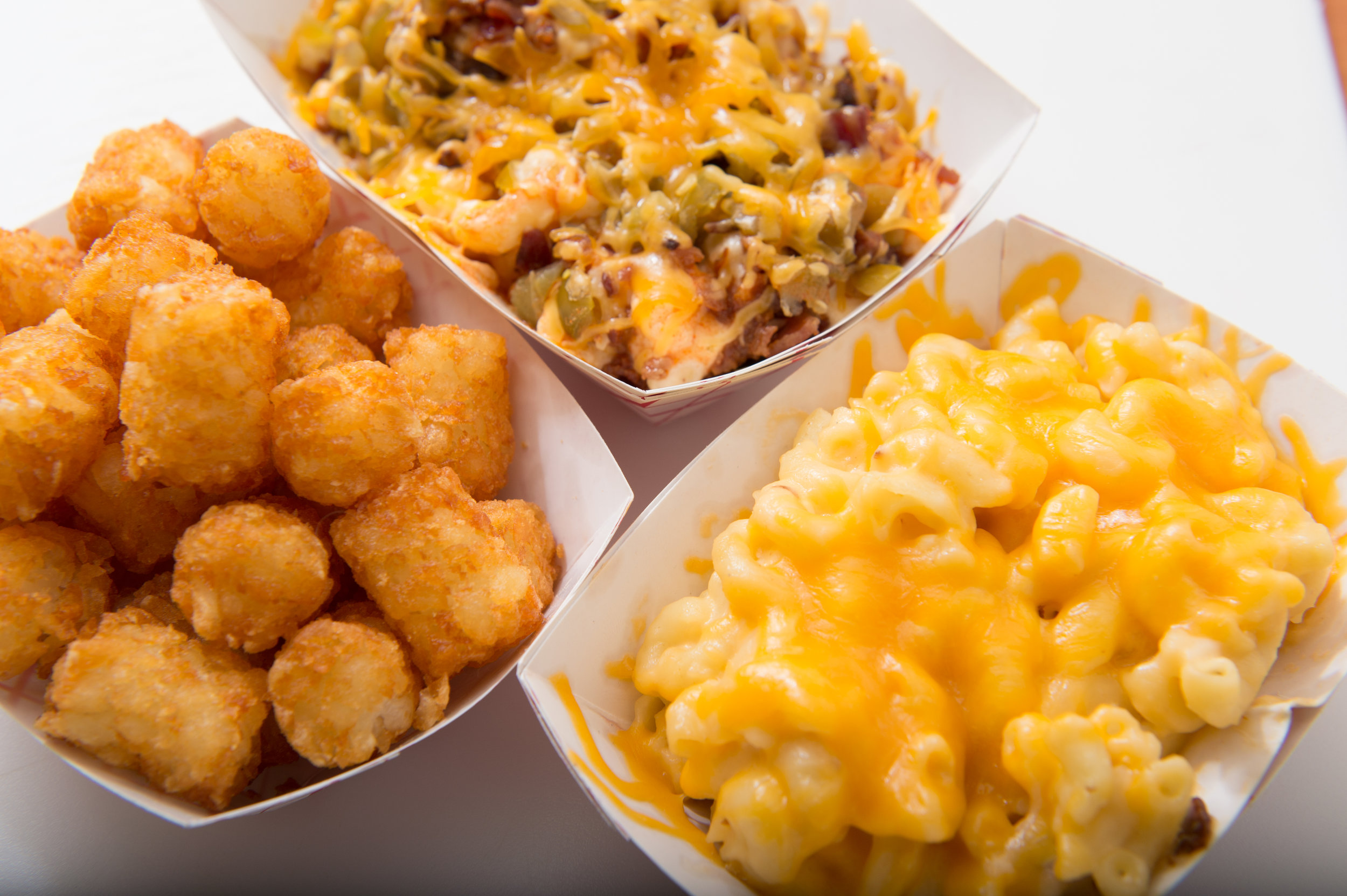 Famous Tots, Creamy Mac N Cheese or Loaded. Which side do you want?