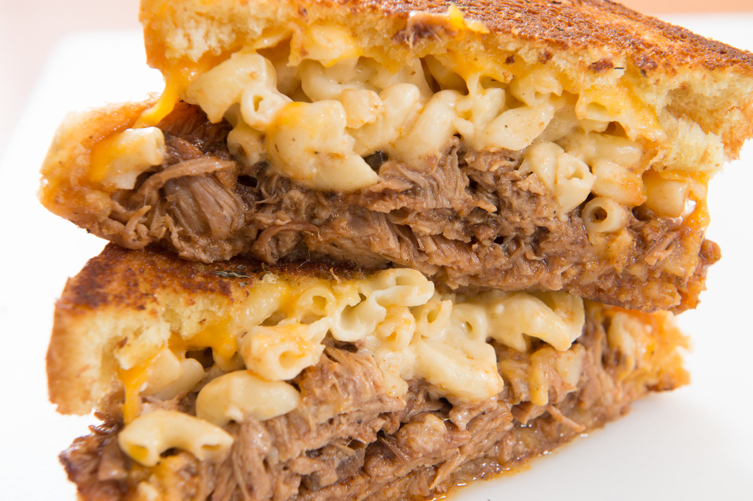 Royale  - BBQ pulled pork topped with creamy mac n cheese and more cheddar cheese on grilled texas toast.