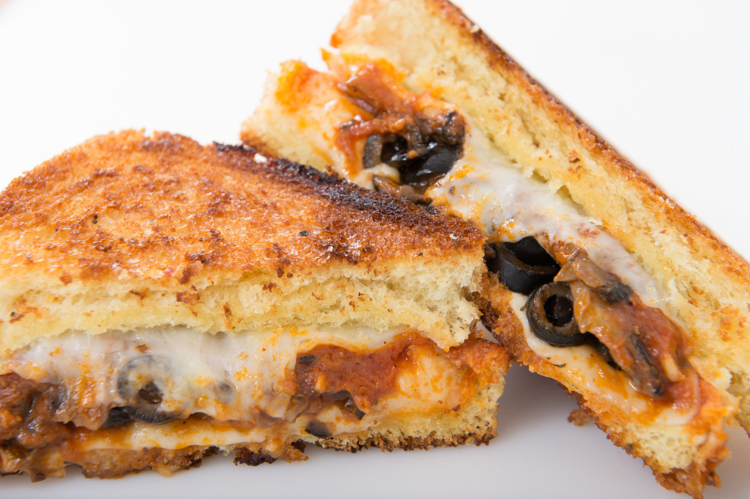 The Mario  - Provolone, marinara, sauteed mushrooms and black olives on grilled texas toast.