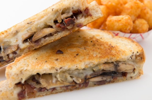 Baron  - Swiss cheese with sauteed mushrooms, sauteed onions and apple wood smoked bacon on basil buttered light rye.