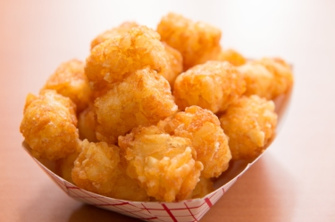 Famous Tots  - Deep fried tater tots with our special seasoning.