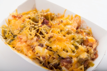 Loaded Mac  - Creamy mac and cheese topped with bacon, pickled jalapenos and hot sauce.