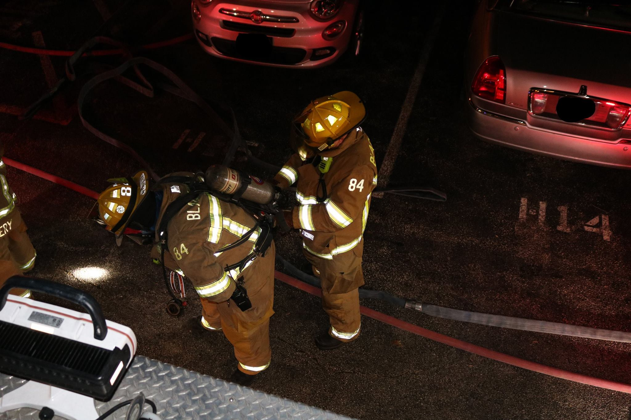 Firefighter McCann changes Firefighter Dunlap's SCBA Cylinder.