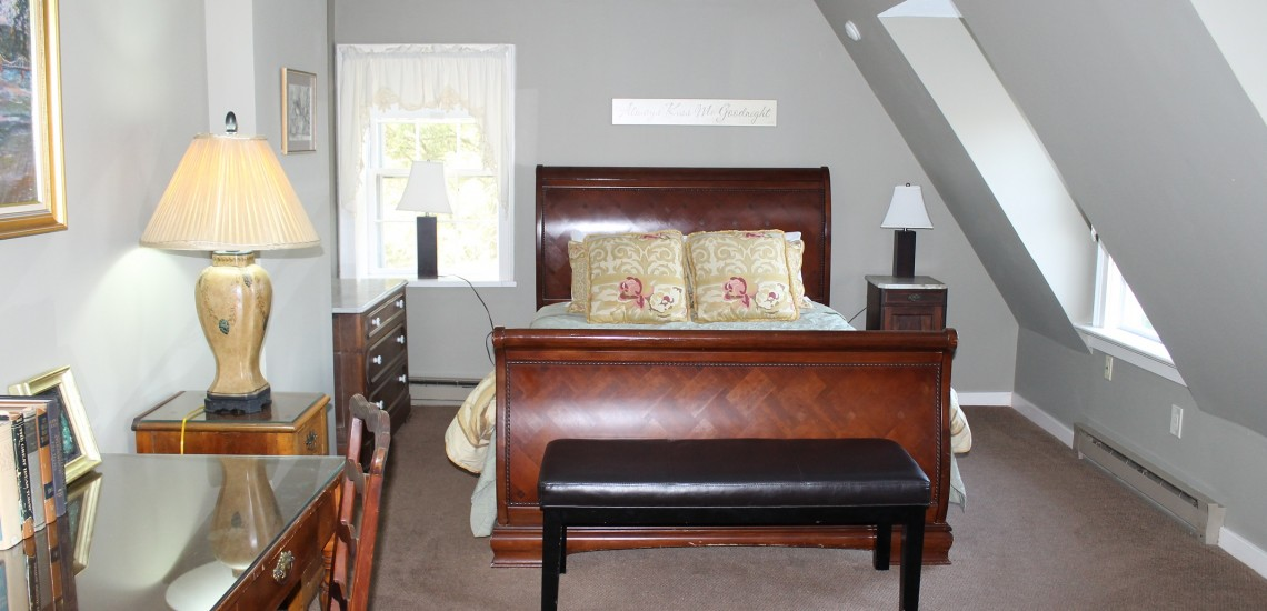 Fetterman Suite - Room 6 is located on the second floor, situated on the river side overlooking the terrace and river. This suite has a stunning view of the river and bridge. It has a queen size bed sleigh bed, private bath, writing desk and sitting area with a flat screen TV.  WiFi