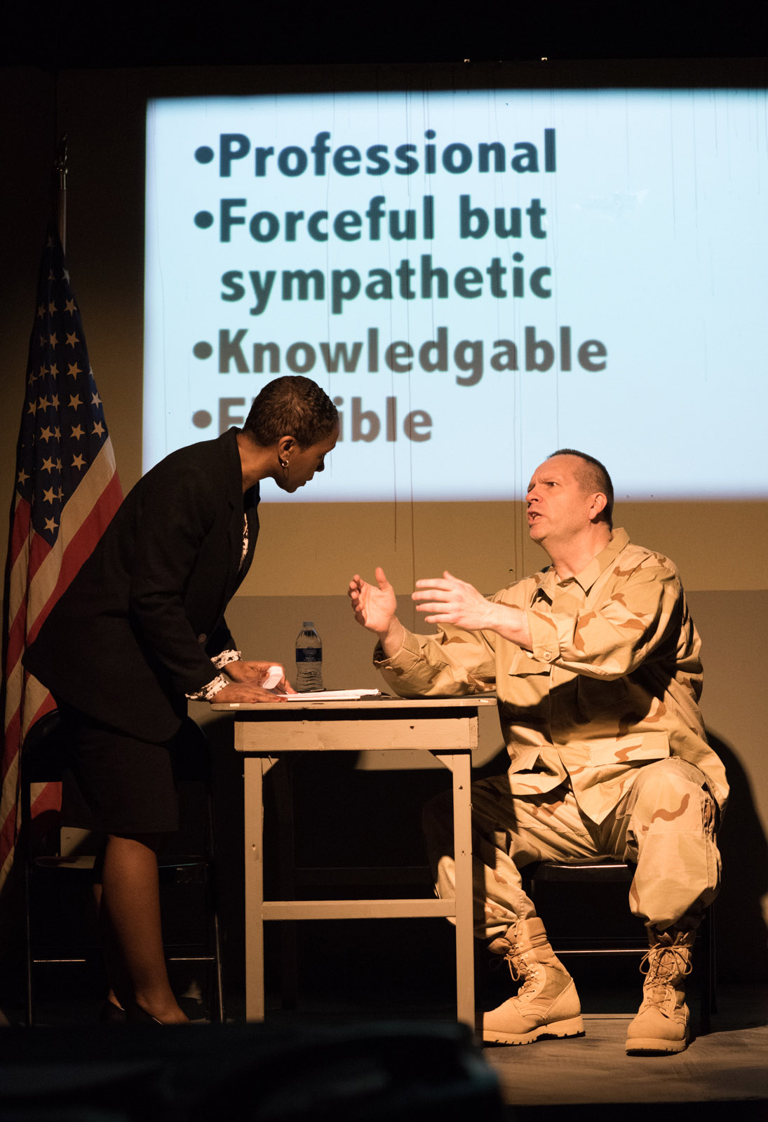 """Shariba Rivers as Dr. O'Brien and Tony St. Clair as Col. Lewis in """"Skin for Skin"""" from The Agency Theatre Collective. Photo by Bill Richert."""