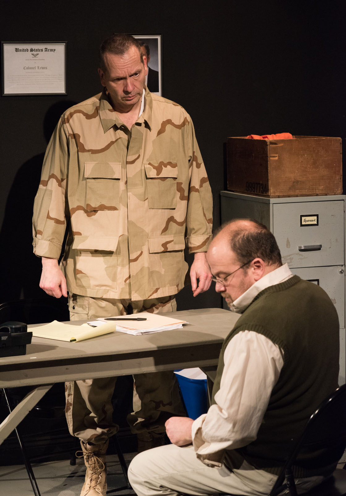 """Tony St. Clair as Col. Lewis and Steve Silver as Ayyub in """"Skin for Skin"""" from The Agency Theatre Collective. Photo by Bill Richert."""