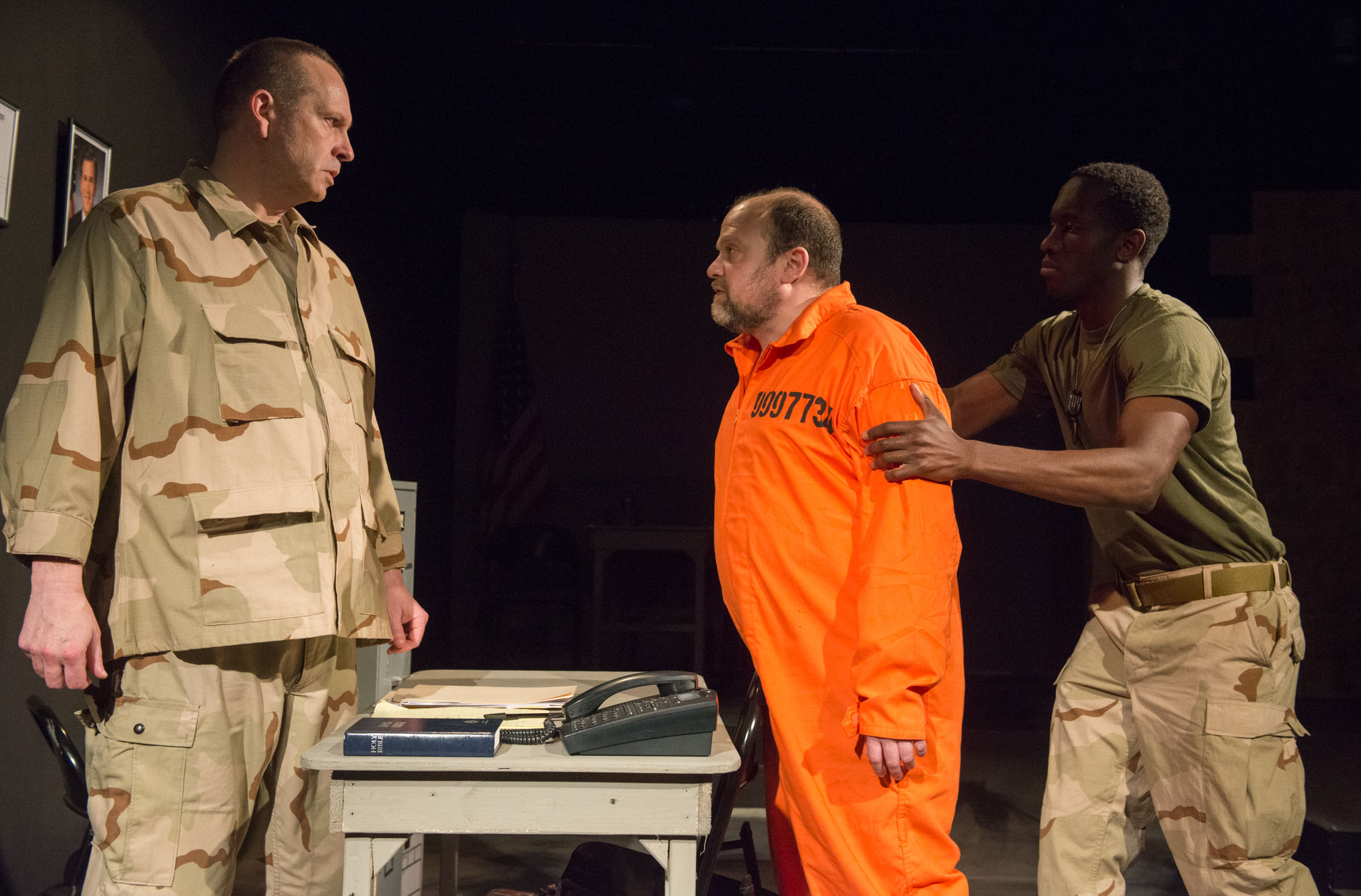 """Tony St. Clair as Col. Lewis, Steve Silver as Ayyub,and David Goodloe as Pvt. Michaels in """"Skin for Skin"""" from The Agency Theatre Collective. Photo by Bill Richert."""
