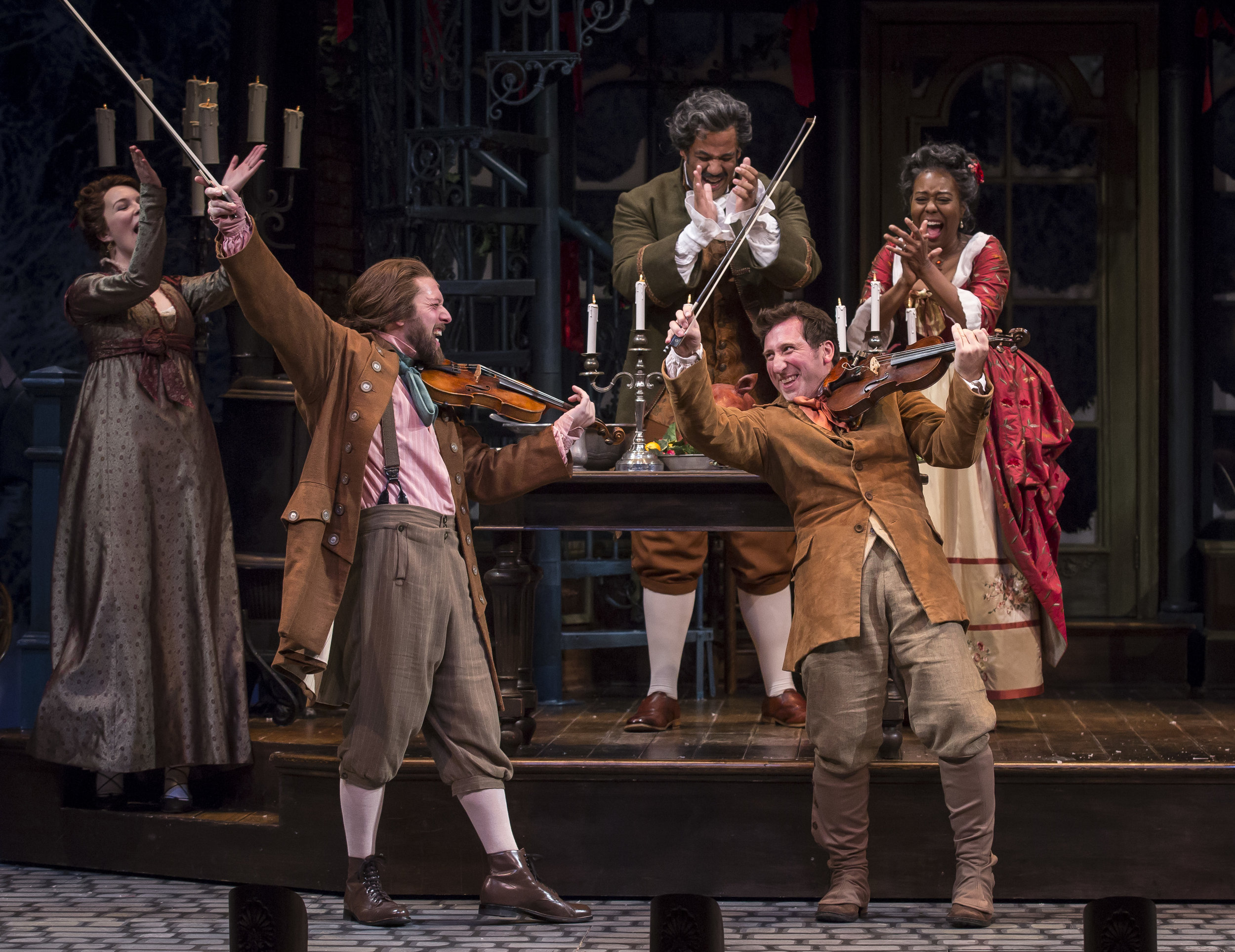 Ali Burch, Andrew Coil  (Musician/Fiddler), Jonah D. Winston (Mr. Fezziwig), Penelope  Walker (Mrs.Fezziwig) and  Gregory Hirte (Musician, Fiddler) in the 40th annual production of  A Christmas Carol , directed by Henry Wishcamper at Goodman Theatre.