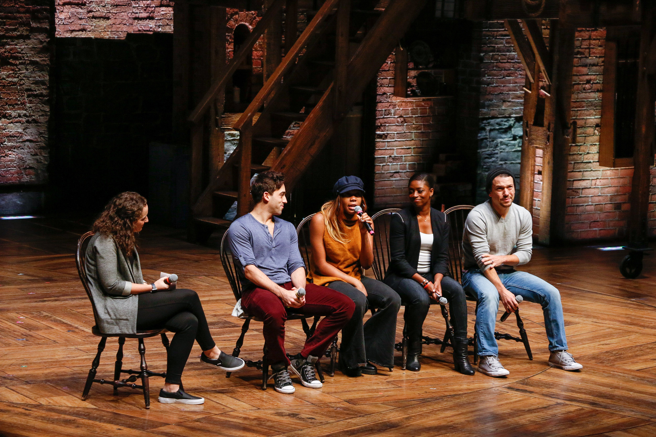 Members of the cast of Hamilton answer questions submitted by students in part of The Hamilton Education Program at CIBC Theatre. Photo by Mary Crylen.
