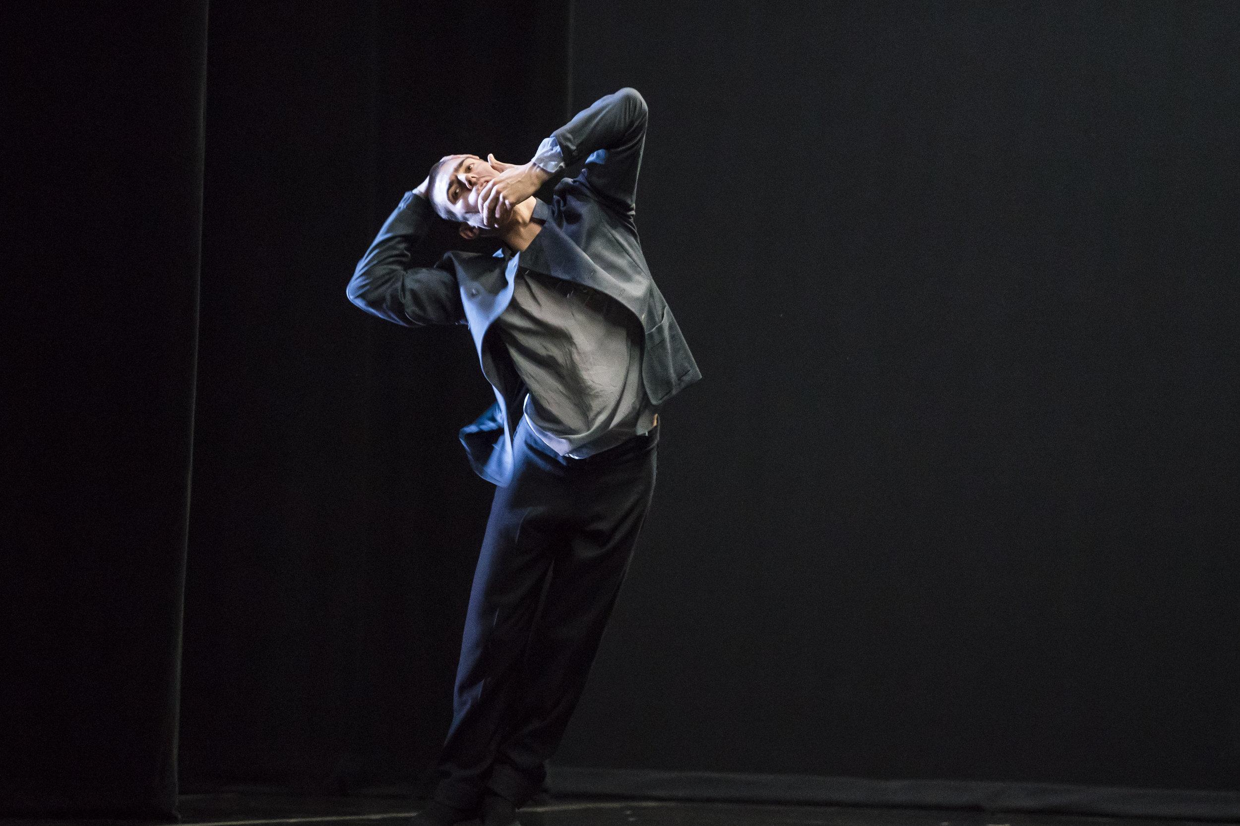 Hubbard Street Dancer Michael Gross in Crystal Pite's  Grace Engine.  Photo by Todd Rosenberg.