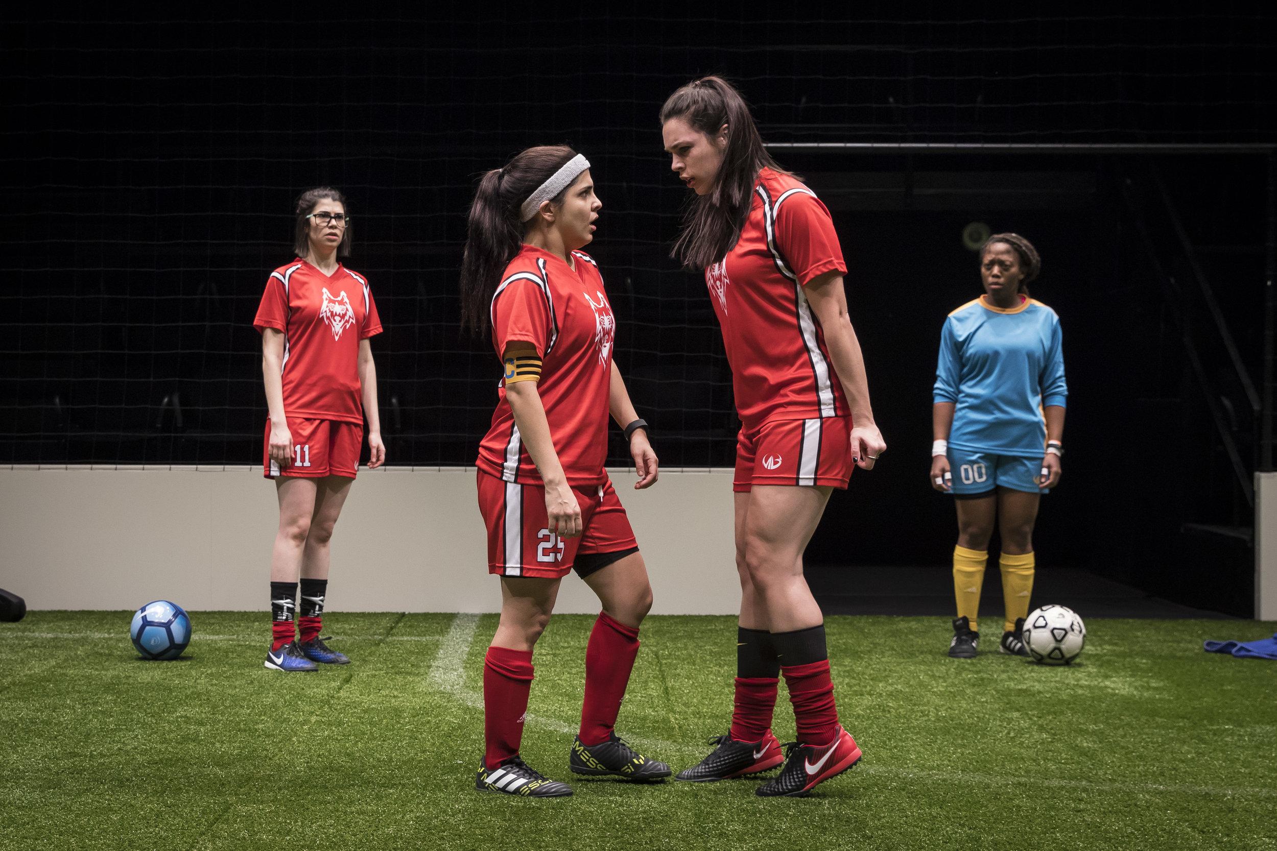 Sarah Price (#11), Isa Arciniegas (#25), Natalie Joyce  (#7) and  Angela Alise (#00) in  The Wolves by Sarah DeLappe. Photo credit: Liz Lauren