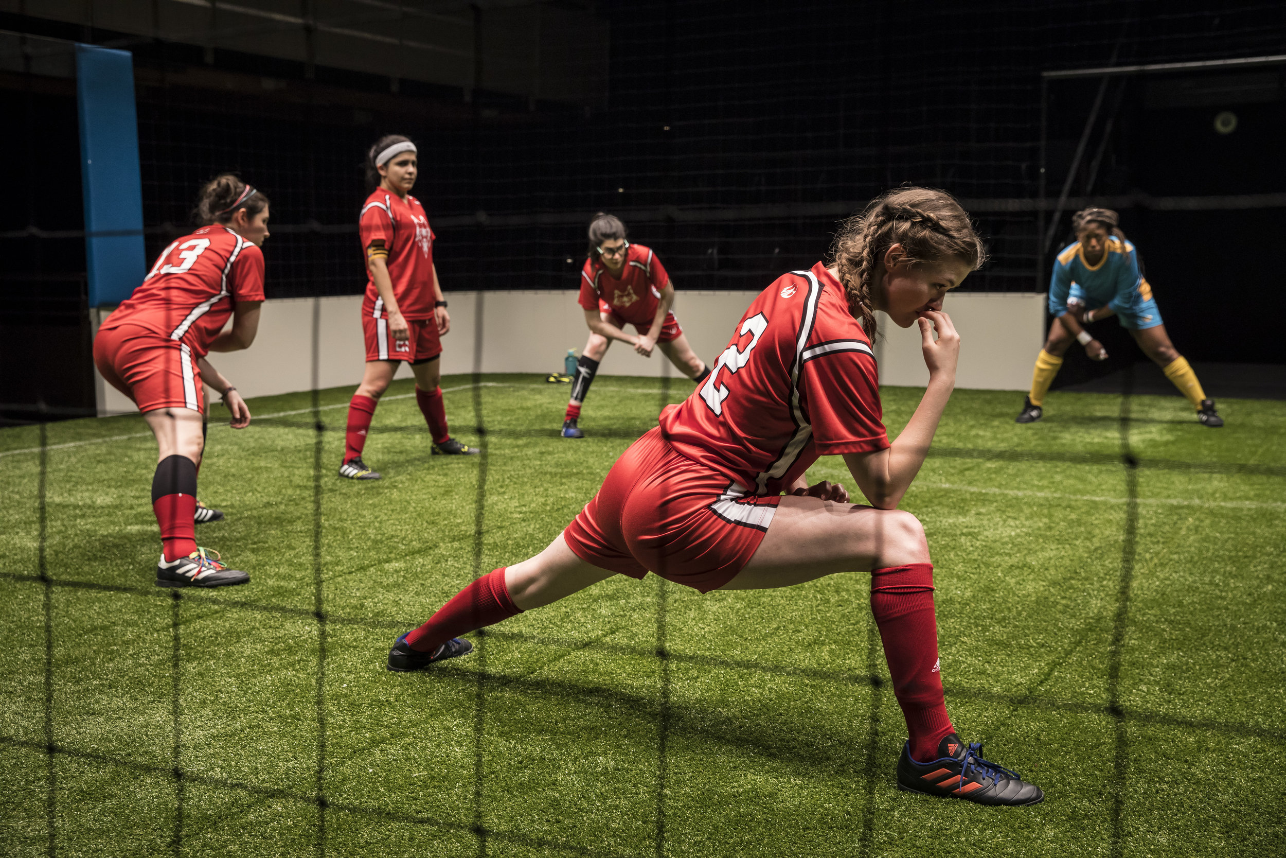 Taylor Blim (#2), Mary Tilden (#13), Isa Arciniegas  (#25), Sarah Price (#11) and  Angela Alise (#00) in  The Wolves by Sarah DeLappe. Photo credit: Liz Lauren.