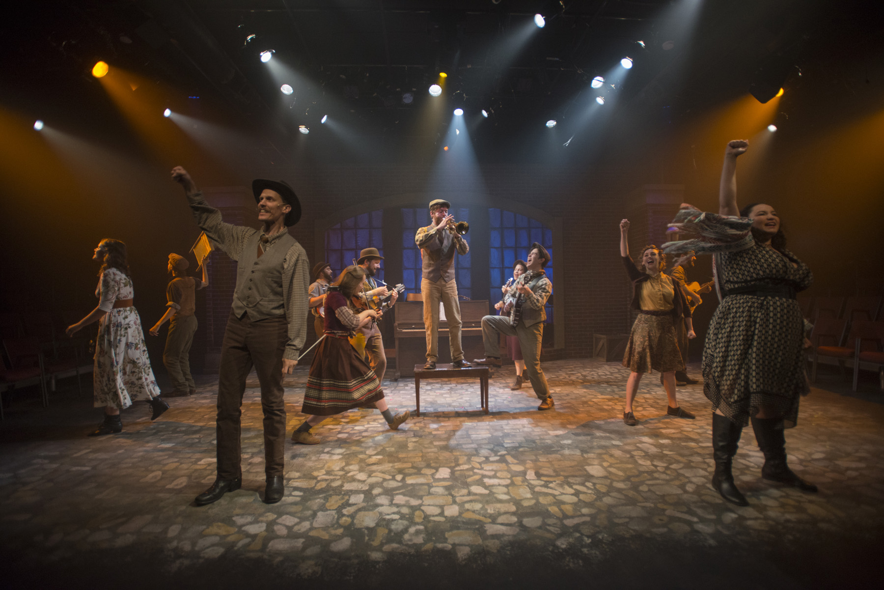 (left to right)  Amanda Giles ,  Joey Harbert ,  Erik Pearson ,  Eric Loughlin, Elleon Dobias ,  Mike Mazzocca ,  T.J. Anderson ,  Sarah Beth Tanner ,  Kelan M. Smith ,  Melanie Vitaterna ,  Josiah Robinson  and  Bridget Adams-King  in  Underscore Theatre Company  and  The Den Theatre's  new musical  HAYMARKET . Photo by Michael Brosilow.
