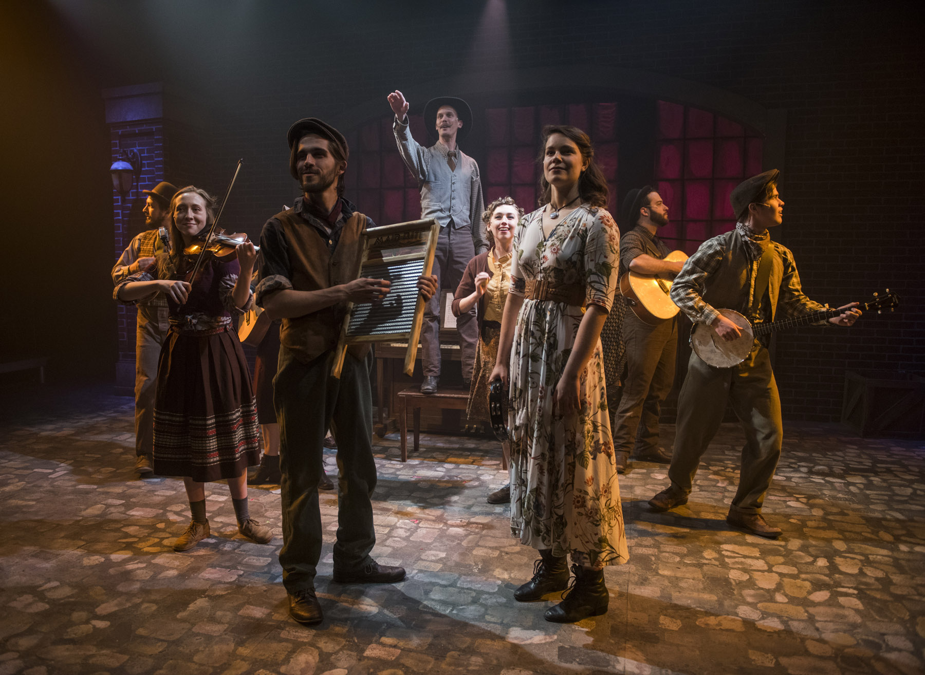 (left to right)  Mike Mazzocca ,  Elleon Dobias ,  Joey Harbert ,  Erik Pearson ,  Melanie Vitaterna ,  Amanda Giles ,  Josiah Robinson  and Kelan M. Smith in  Underscore Theatre Company  and  The Den Theatre's  new musical  HAYMARKET . Photo by Michael Brosilow.