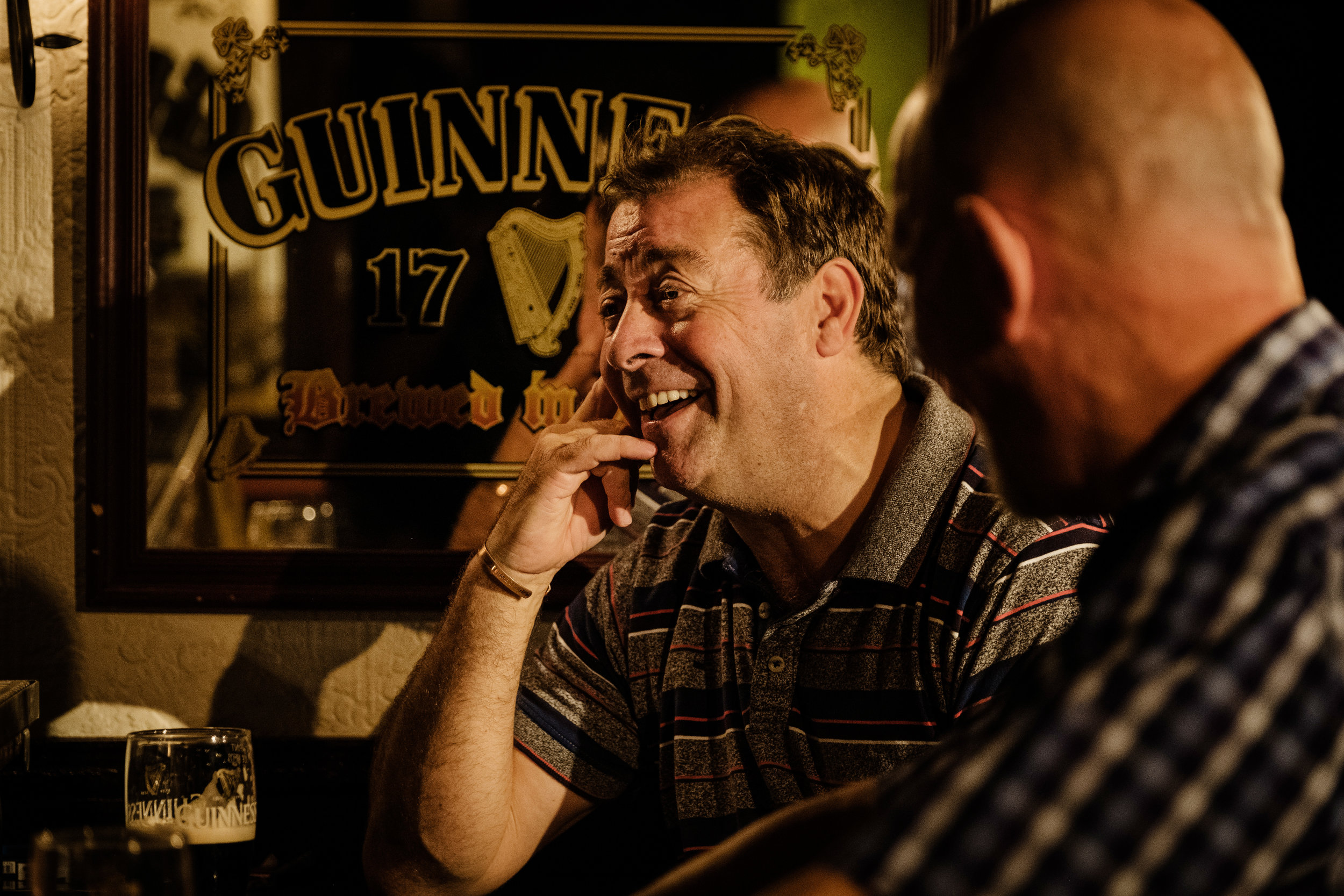 Philip Judge laughs heartily in conversation with Liam Carney in the Abbey Theatre's  Two Pints,  written by Roddy Doyle. Photo by Ros Kavanagh.