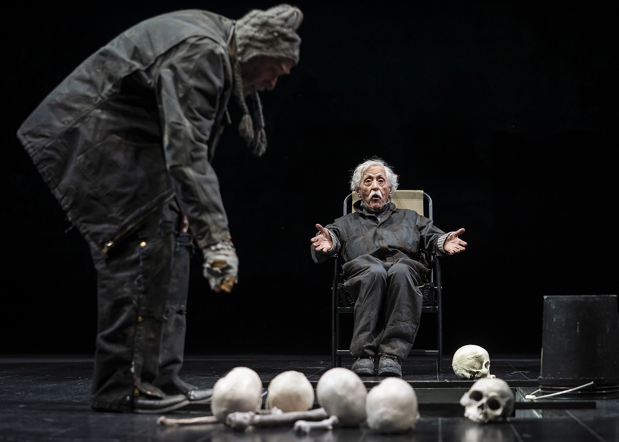 Gravediggers (Greg Vinkler and Mike Nussbaum) banter while preparing for a burial in Chicago Shakespeare Theater's production of  Hamlet , directed by Barbara Gaines, in the Courtyard Theater, April 17–June 9, 2019. Photo by Liz Lauren.