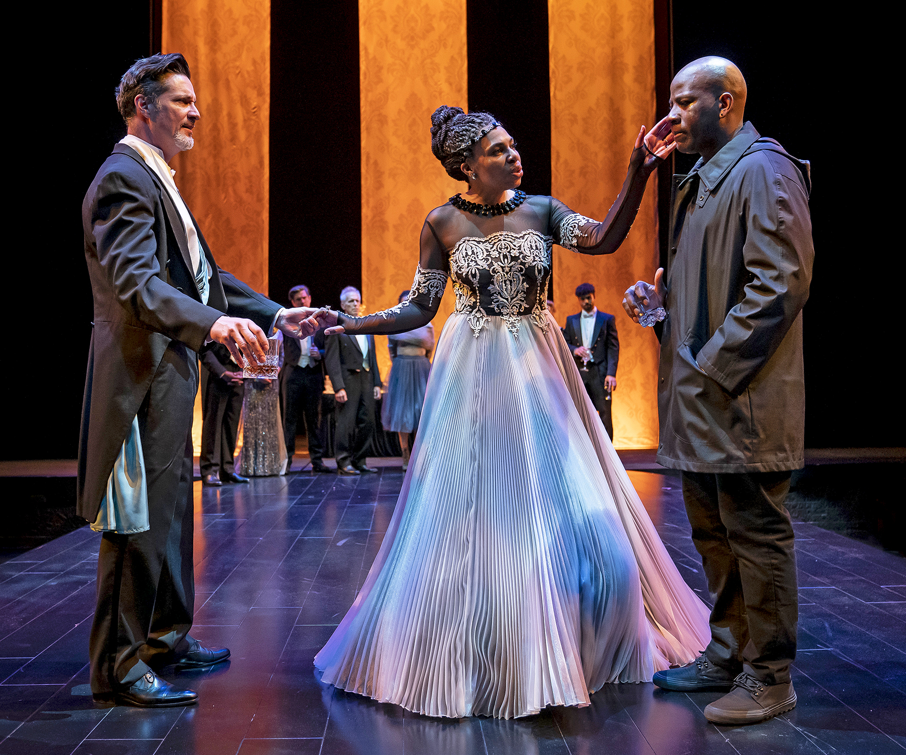 Gertrude (Karen Aldridge, at center) is caught between her son Hamlet (Maurice Jones, at right) and her new husband and king, Claudius (Tim Decker, at left), in Chicago Shakespeare Theater's production of  Hamlet , directed by Barbara Gaines, in the Courtyard Theater, April 17–June 9, 2019. Photo by Liz Lauren.