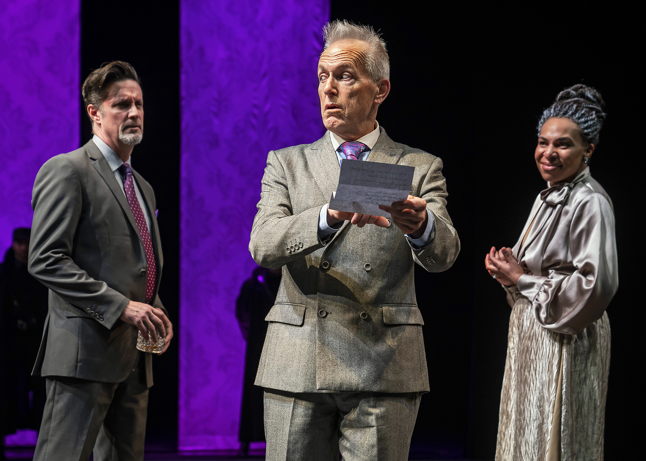 Polonius (Larry Yando, at center) reveals to King Claudius (Tim Decker) and Queen Gertrude (Karen Aldridge) the contents of Hamlet's letter to Ophelia in Chicago Shakespeare Theater's production of  Hamlet , directed by Barbara Gaines, in the Courtyard Theater, April 17–June 9, 2019. Photo by Liz Lauren.