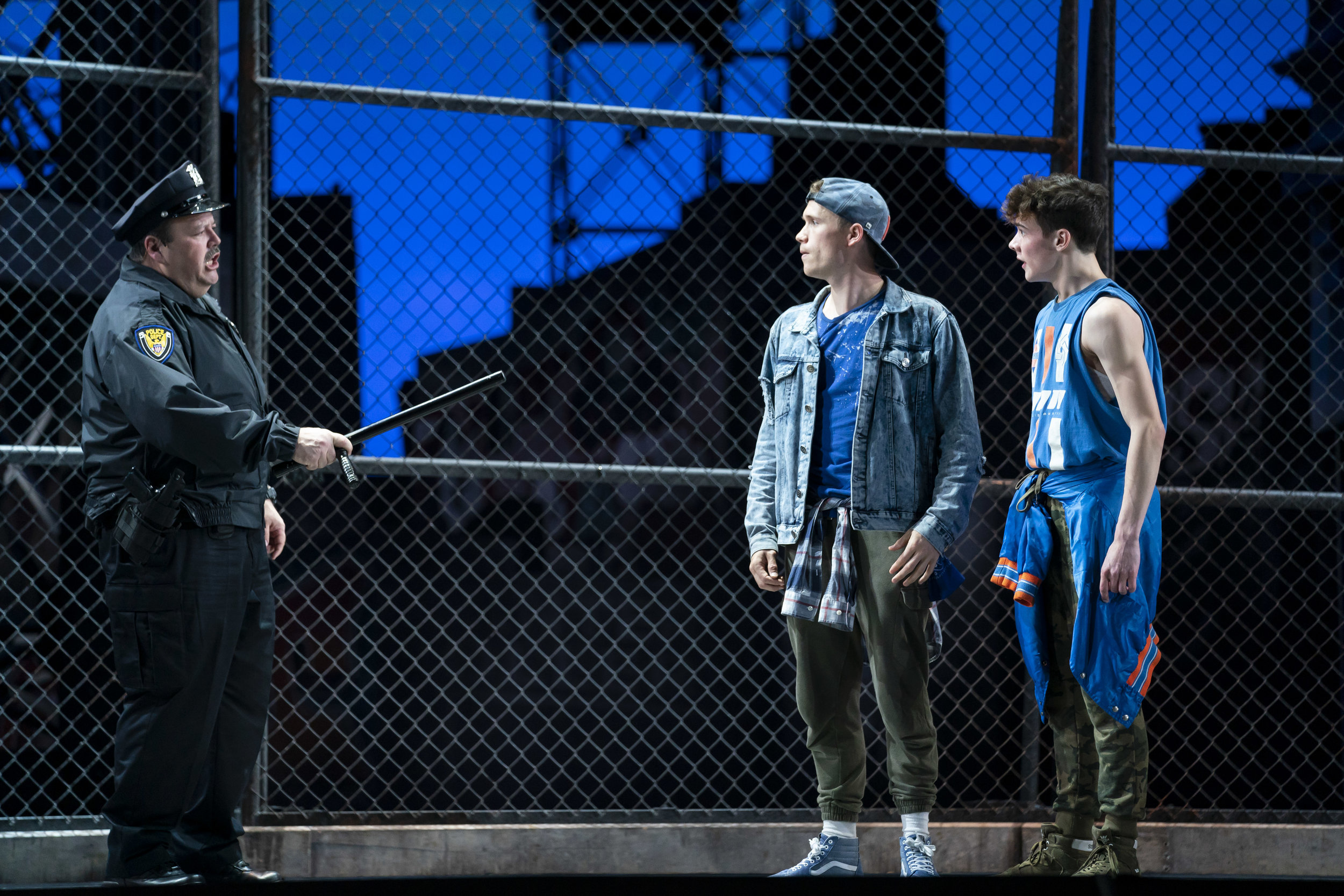 Jerry Kernion, Taylor Simmons, and Jarred Manista in WEST SIDE STORY at Lyric Opera of Chicago. Photo by Todd Rosenberg