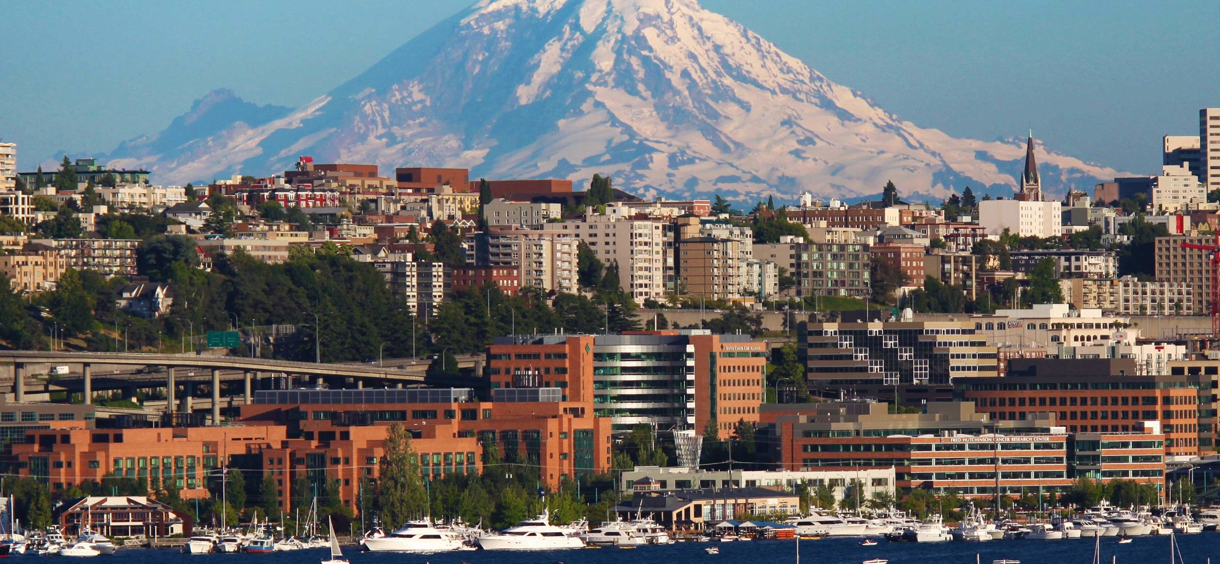 The Fred Hutchinson Cancer Research Center and Seattle Cancer Care Alliance in front of Mount Rainier. South Lake Union, Seattle, WA..