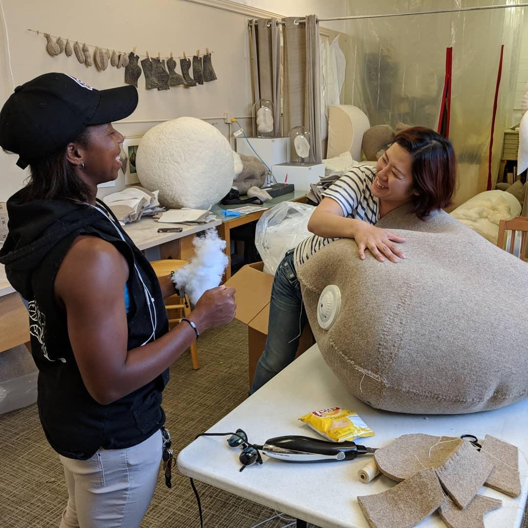 Jordan and Jessica helping stuff a stitched sculpture.