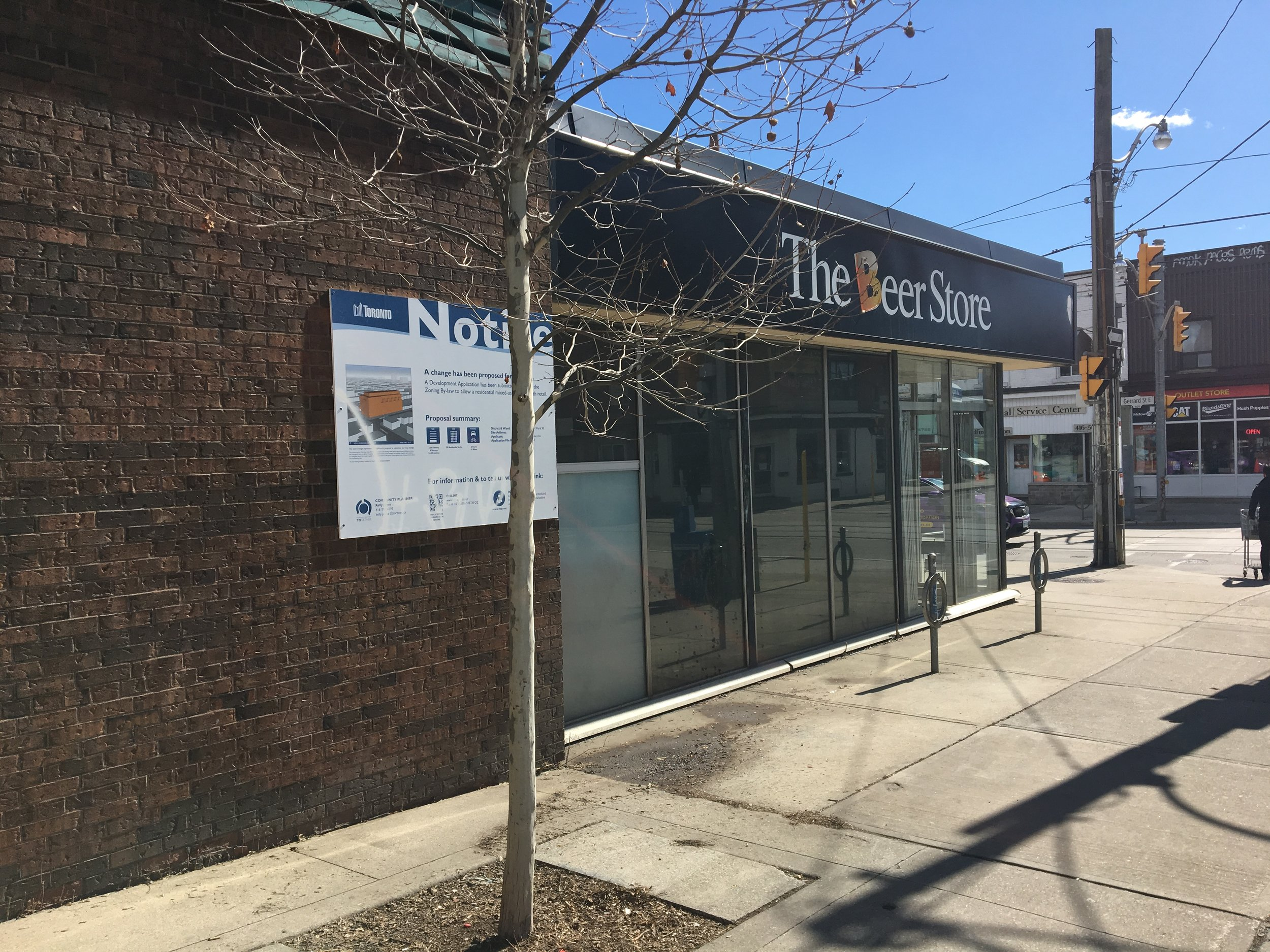 Beer store at Gerrard and Logan redevelopment notice. A six story condo with retail is being planned.
