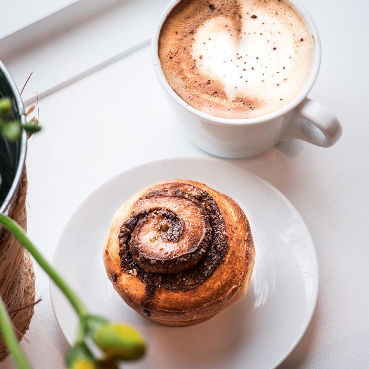 Cozy up with Elvy & Flo's house-made cinnamon brioche and a latte // SUE KEEFE