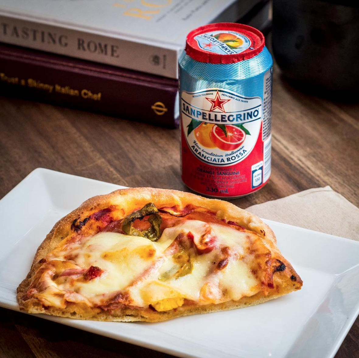 """Pop in for a slice of Sweet Heat pizza. Piled high with mortadella, chunks of fresh pineapple, and spicy banana peppers covered in a blanket of gooey provolone, this pizza is sure to cure you of your rainy day blues,"" // SUE KEEFE"