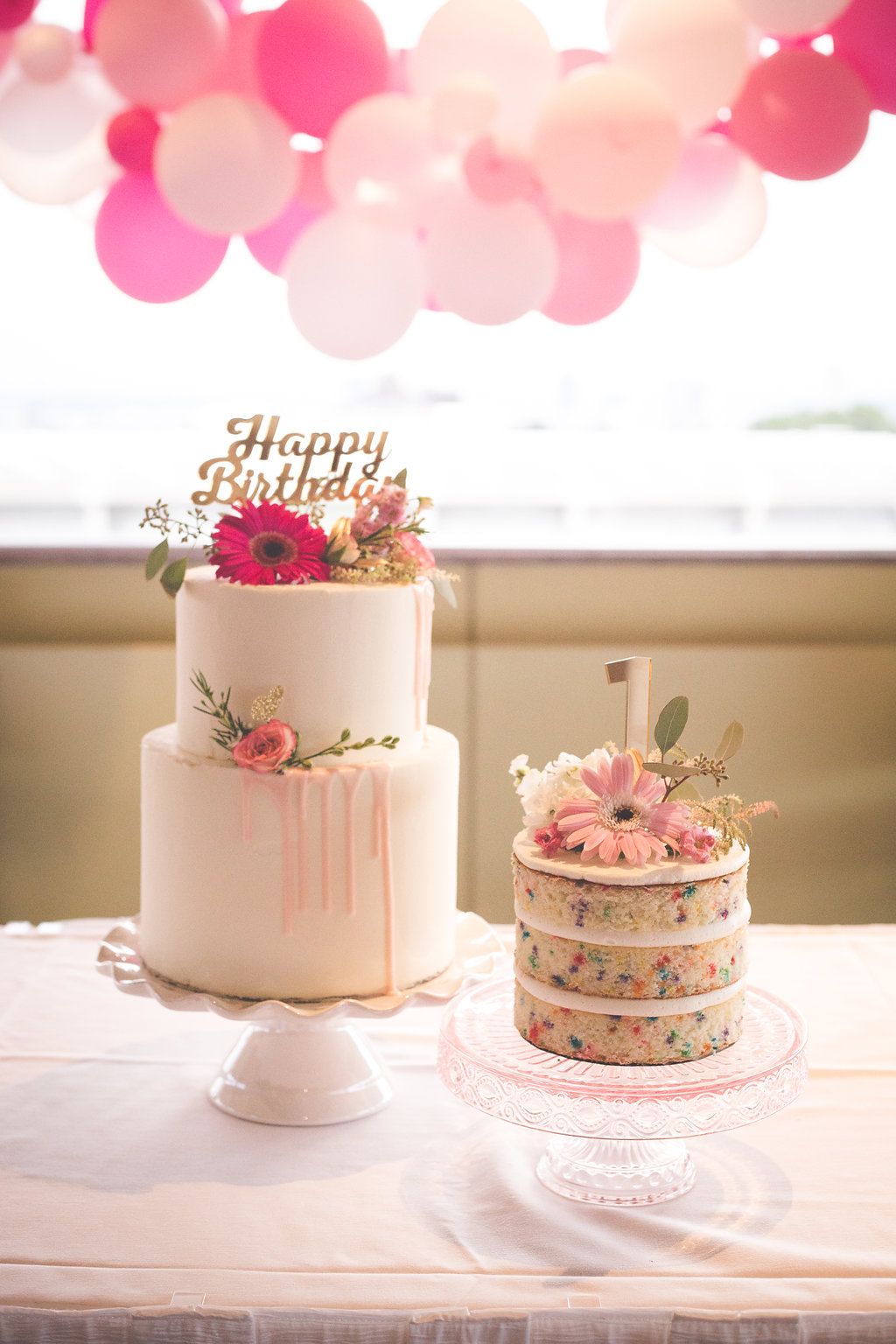 Cakes by Annie Bee Cakery, flowers by Willow Specialty Florist, and cake toppers by  My Minds' Eye.